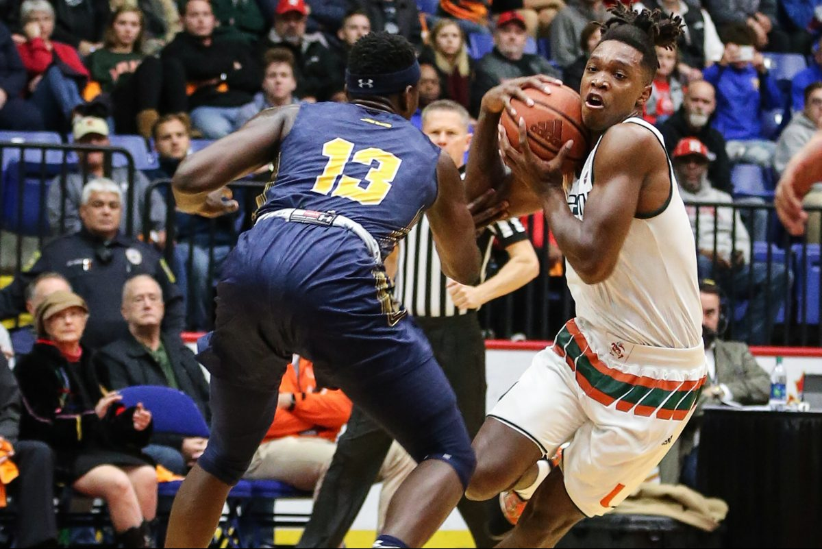 Miami's Lonnie Walker IV, a Reading High School graduate, drives on La Salle's Saul Phiri during the first half at the Santander Arena in Reading.