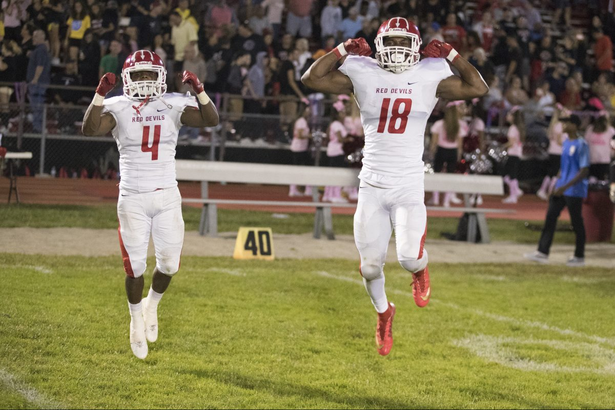 Marc Sykes, Jr., left, and Allan Watson of Rancocas Valley celebrate after their 10-7 win against Lenape on Oct. 6, 2017. CHARLES FOX / Staff Photographer