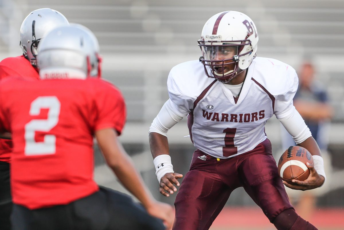 Boys' Latin quarterback Malik Johnson (1) has carried  142 times for 1,018 yards and 14 touchdowns.