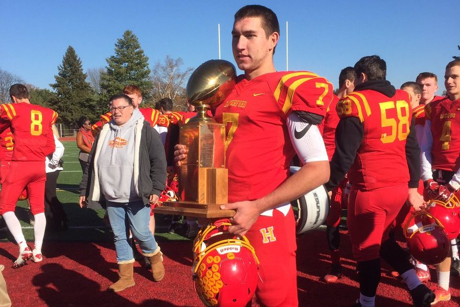 Haverford High quarterback Jake Ruane holds the trophy after his team beat Upper Darby, 14-7, on Thanksgiving Day.