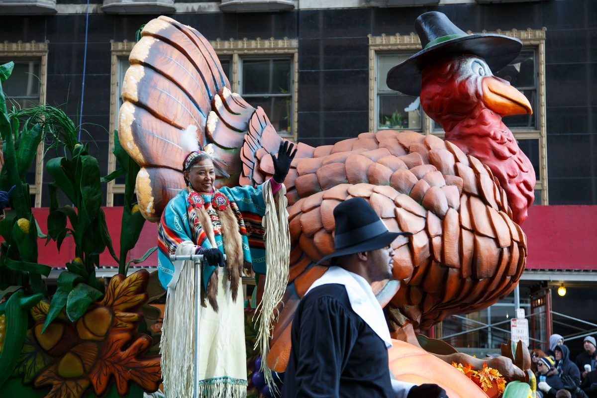 Parade participants wave from the first float of the 98th Annual 6ABC Dunkin´ Donuts Thanksgiving Day Parade.