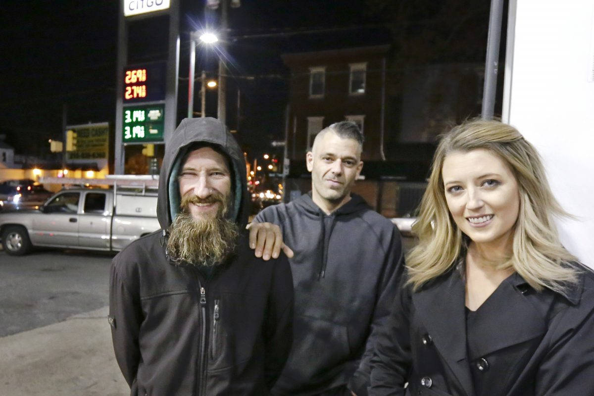 Johnny Bobbitt Jr. (left), Mark D´Amico, and Kate McClure at the CITGO station where Bobbitt spent his last $20 to buy gas for McClure.