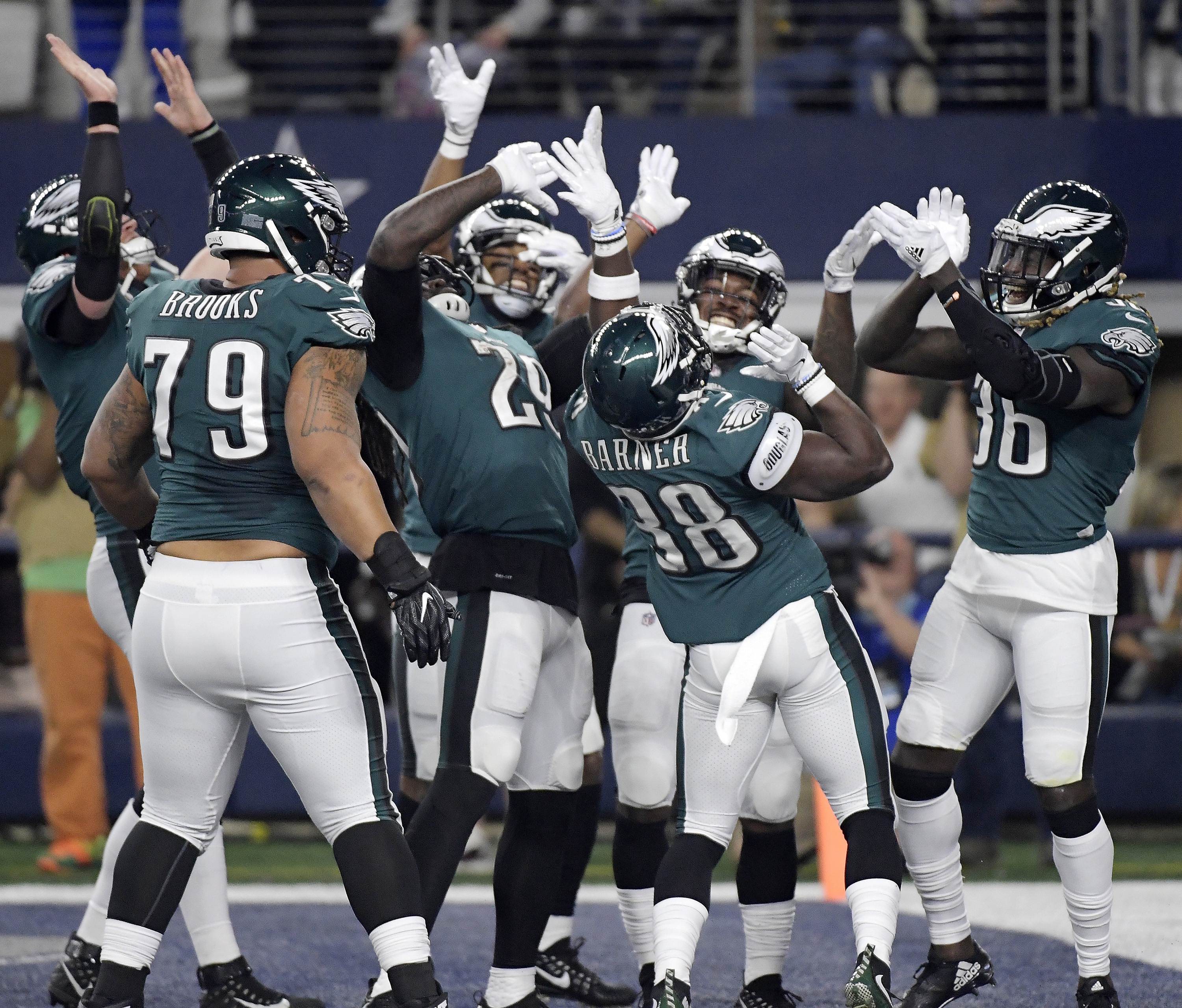 Eagles players celebrate a touchdown against the Cowboys.