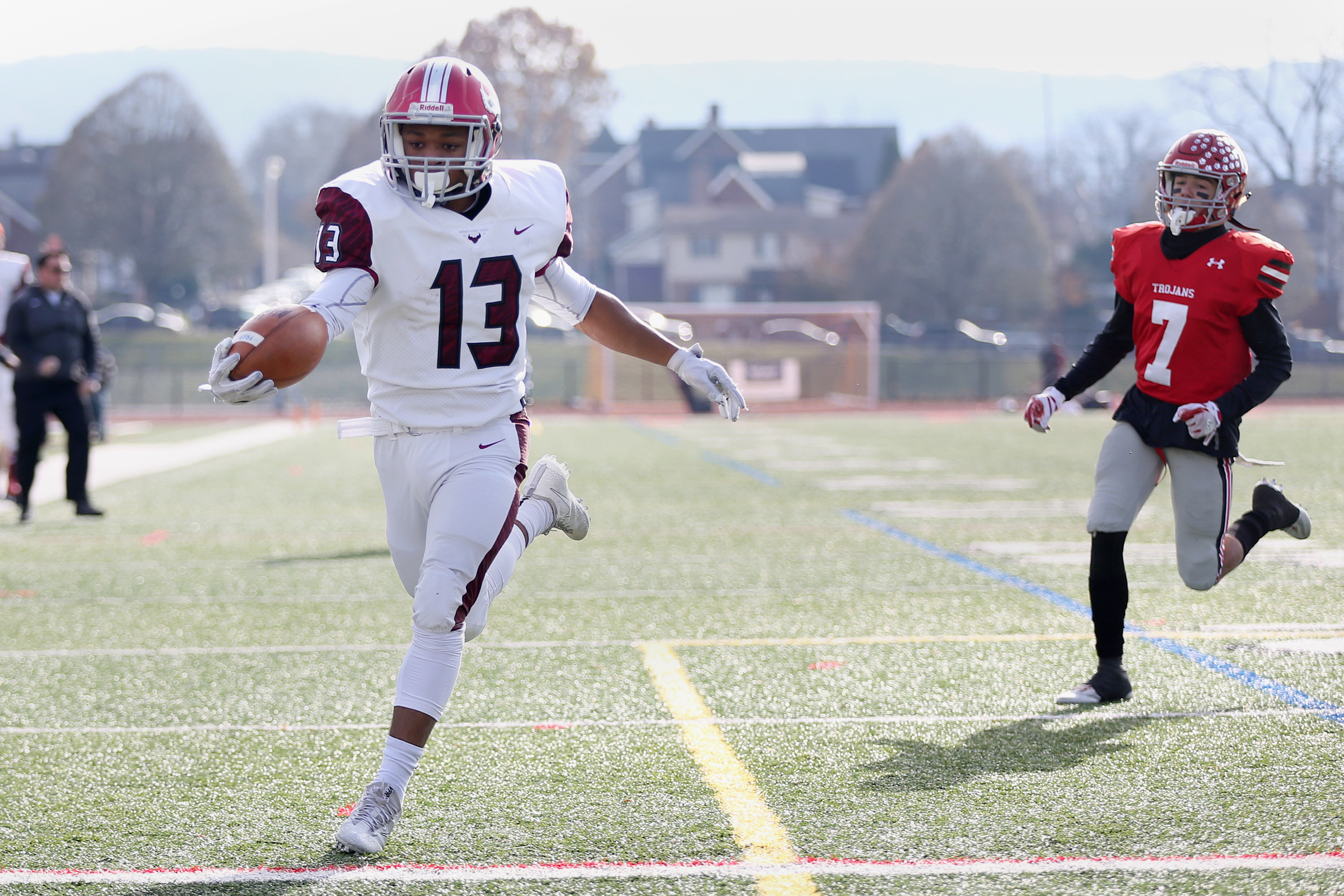 St. Joseph´s Prep´s Marques Mason (left) outruns Parkland´s Cole Wetherhold to score a touchdown in the first quarter of their PIAA Class 6A quarterfinal game.