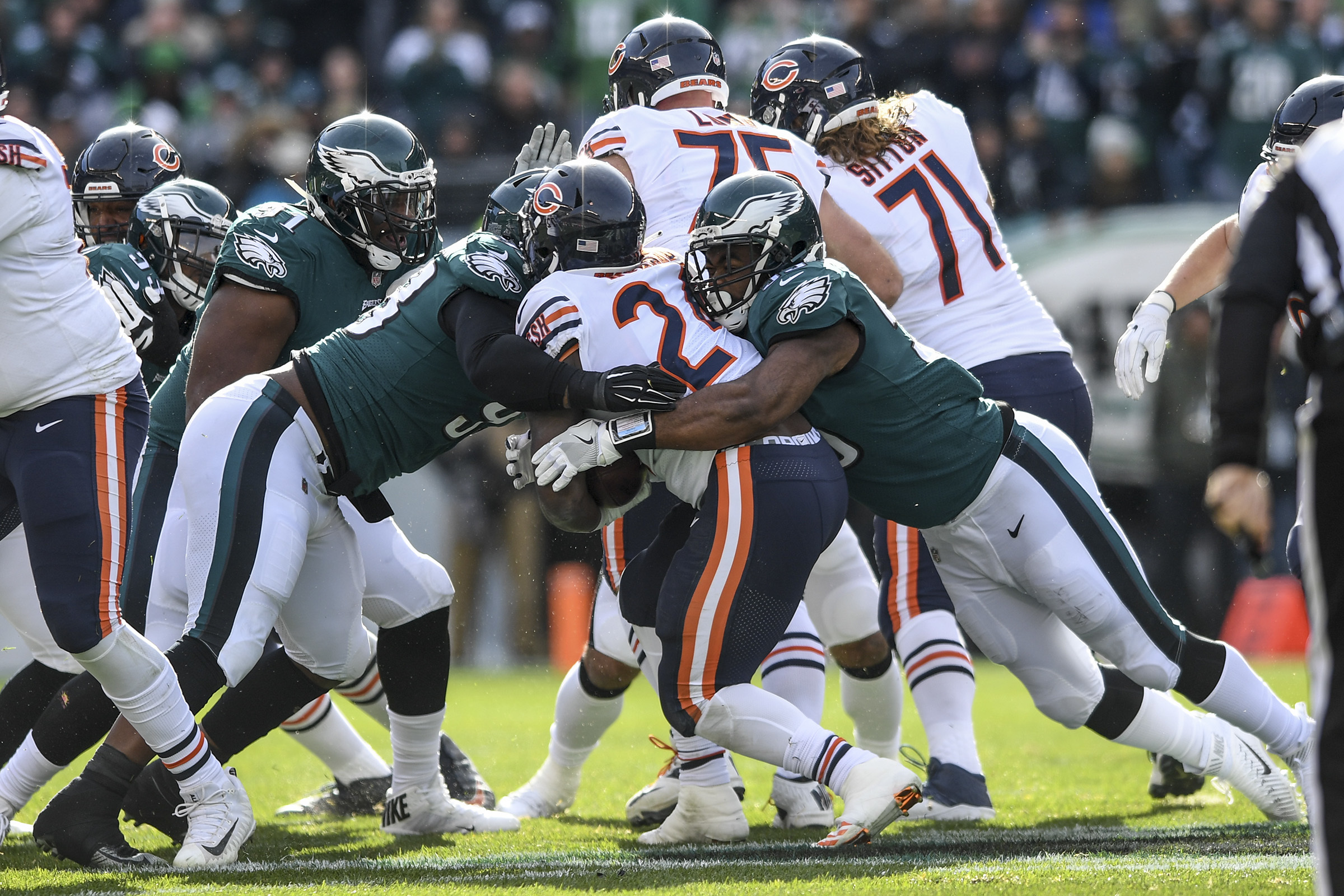 Eagles defensive linemen Tim Jernigan (left) and Brandon Graham (right) stop Chicago running back Jordan Howard for a 1-yard loss on 3rd and 2 in the 1st quarter of the game November 26, 2017 at Lincoln Financial Field. Eagles won 31-3. CLEM MURRAY / Staff Photographer