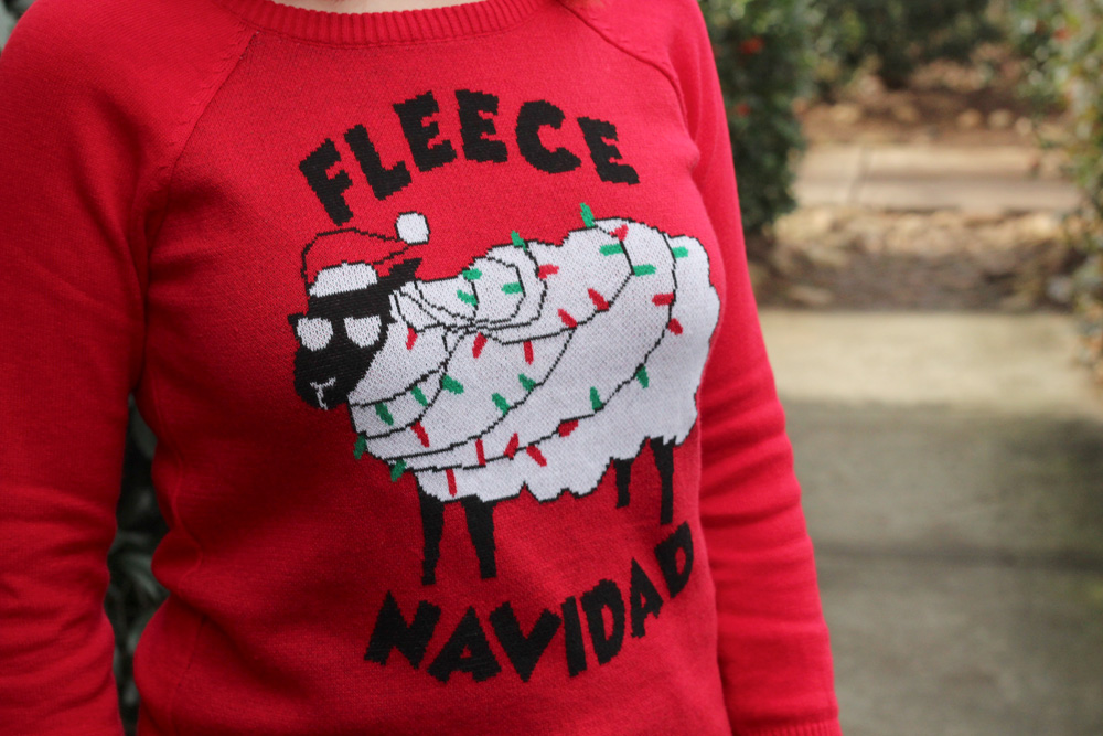 Ugly sweaters are the dress code for an otherwise swanky Art Museum cocktail party . (Photo By Jamie for Red Lol Vintage Fleece Navidad Christmas Sheep Sweater)