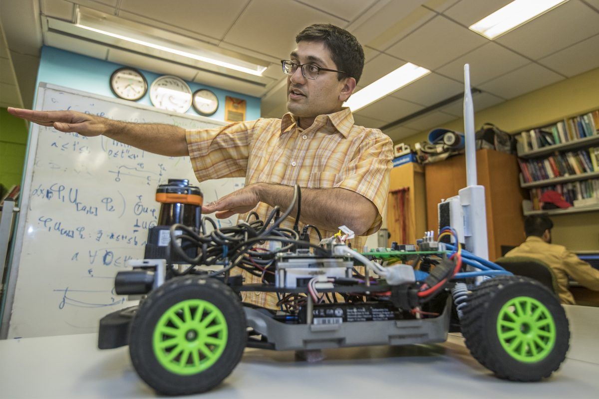 Engineering professor Rahul Mangharam talks about self-driving cars while his F1 Tenth sits right in front of him in his lab at Penn Engineering. The F1 Tenth is 1/10th the size of a Formula One car and it contains self-driving algorithms.