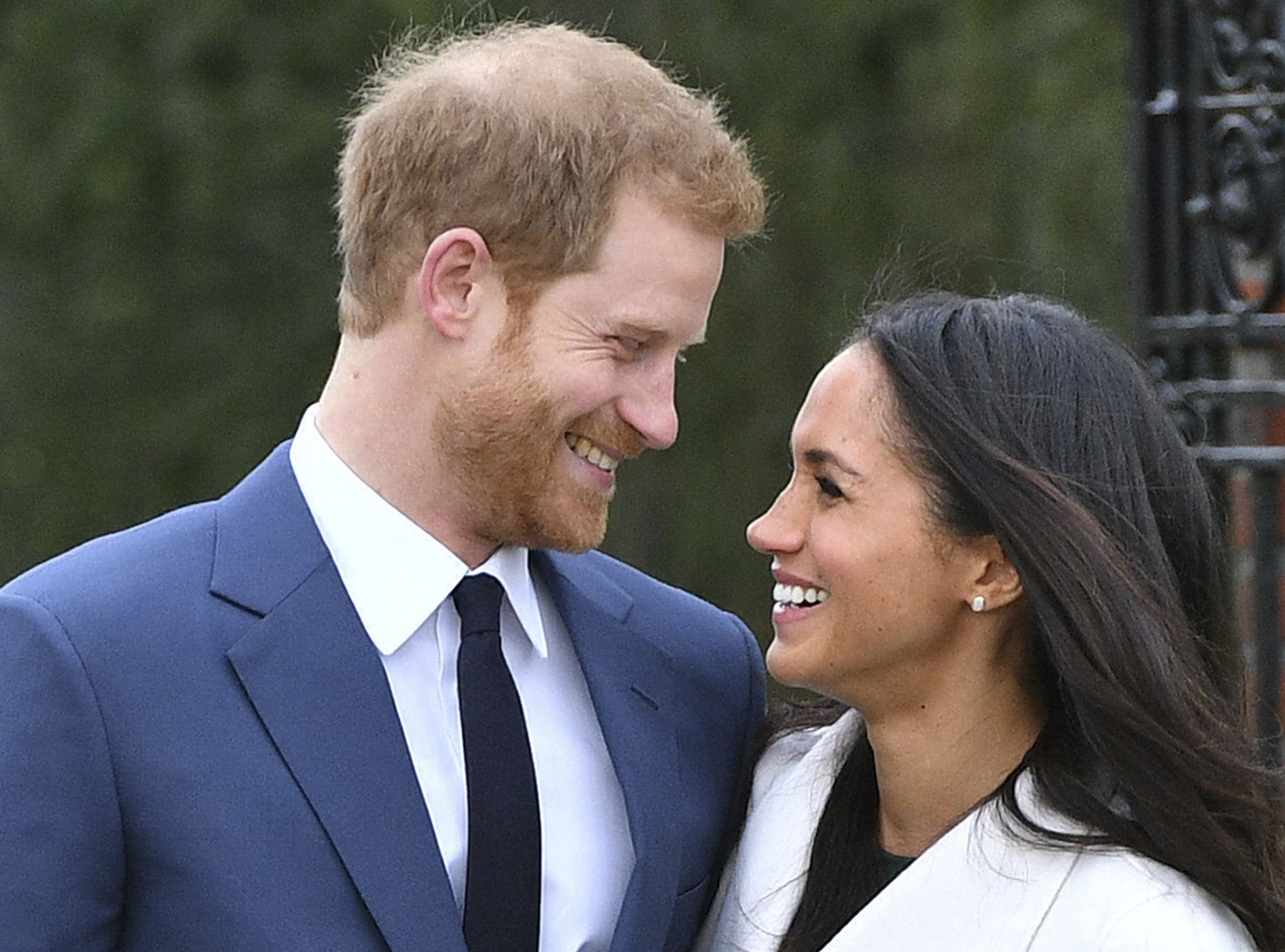 Britain´s Prince Harry and Meghan Markle smile as they pose for the media in the grounds of Kensington Palace in LondonMonday.