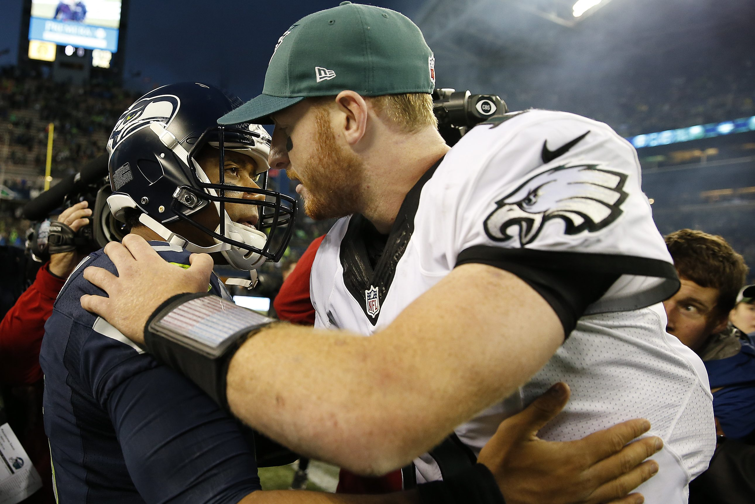 Seahawks' Russell Wilson, left, and Eagles' Carson Wentz, right, embrace after the game. Philadelphia Eagles lose 26-15 to the Seattle Seahawks in Seattle, WA on November 20, 2016. DAVID MAIALETTI / Staff Photographer