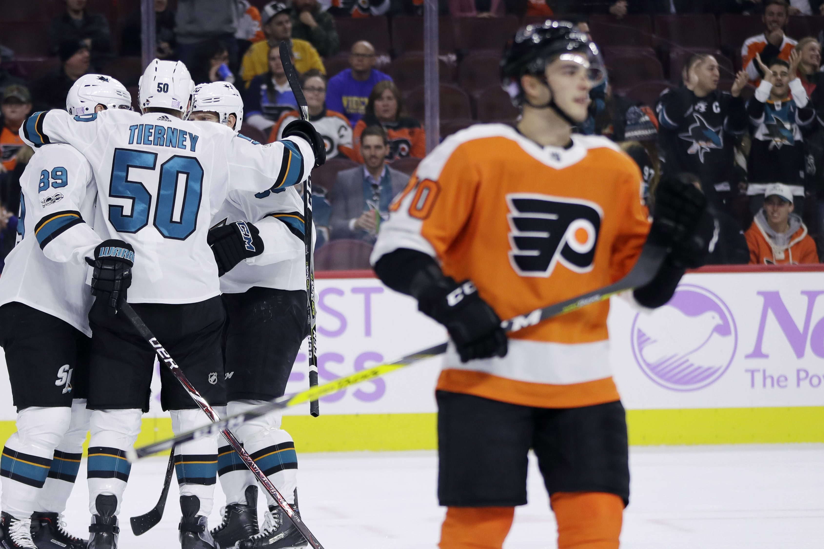 San Jose´s Chris Tierney (50) celebrates with his teammates as Danick Martel (70) looks on dejectedly in the Flyers´ 3-1 loss Tuesday.