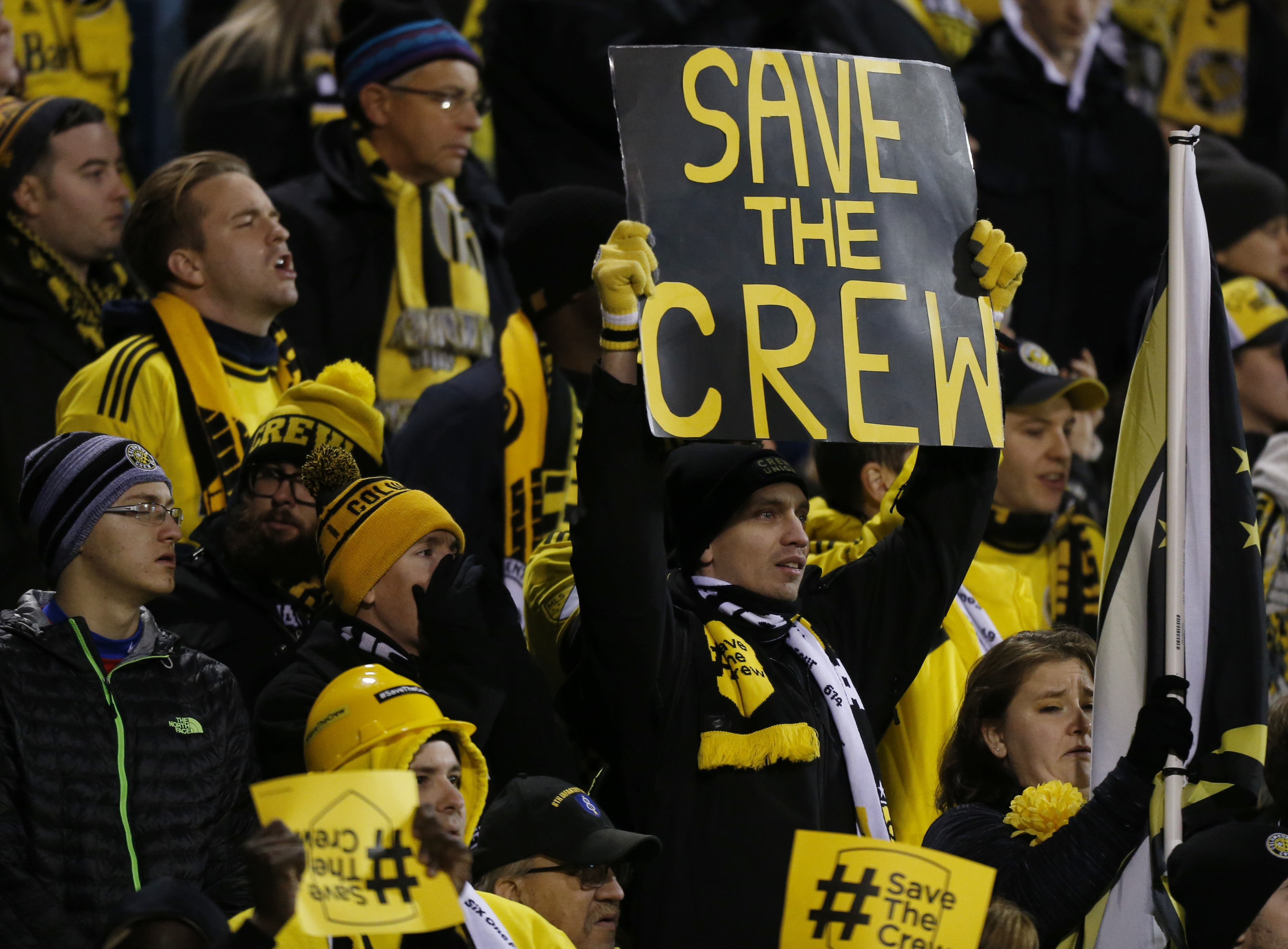 Columbus Crew fans show their support for their team as they play against Toronto FC during the first half of an MLS Eastern Conference championship soccer match Tuesday, Nov. 21, 2017, in Columbus, Ohio. The Crew´s owner has recently threatened to move the team after the 2018 season. (AP Photo/Jay LaPrete)