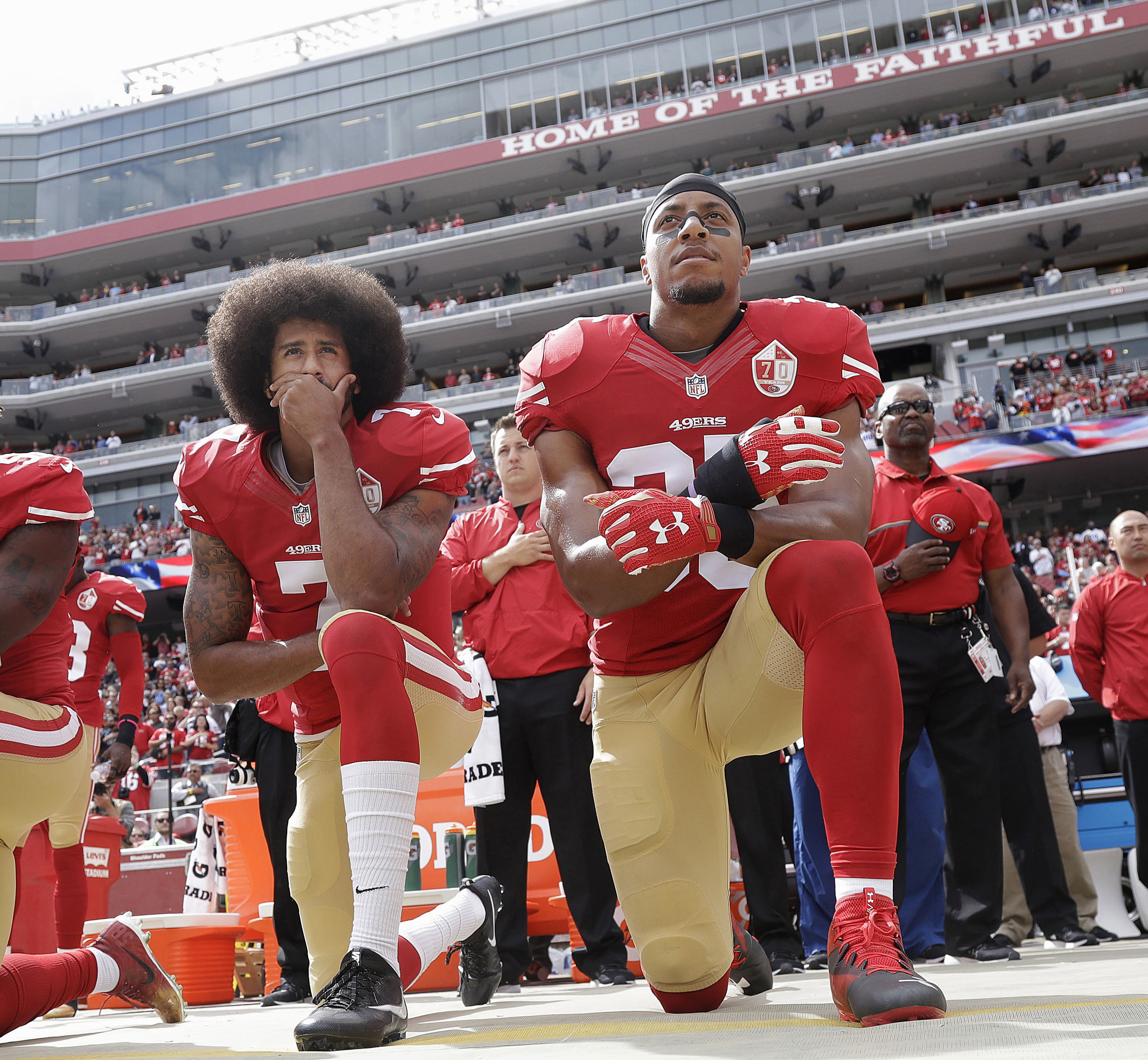 San Francisco safety Eric Reid (right) kneels next to former 49ers quarterback Colin Kaepernick during the national anthem before a game last season. (AP Photo/Marcio Jose Sanchez)