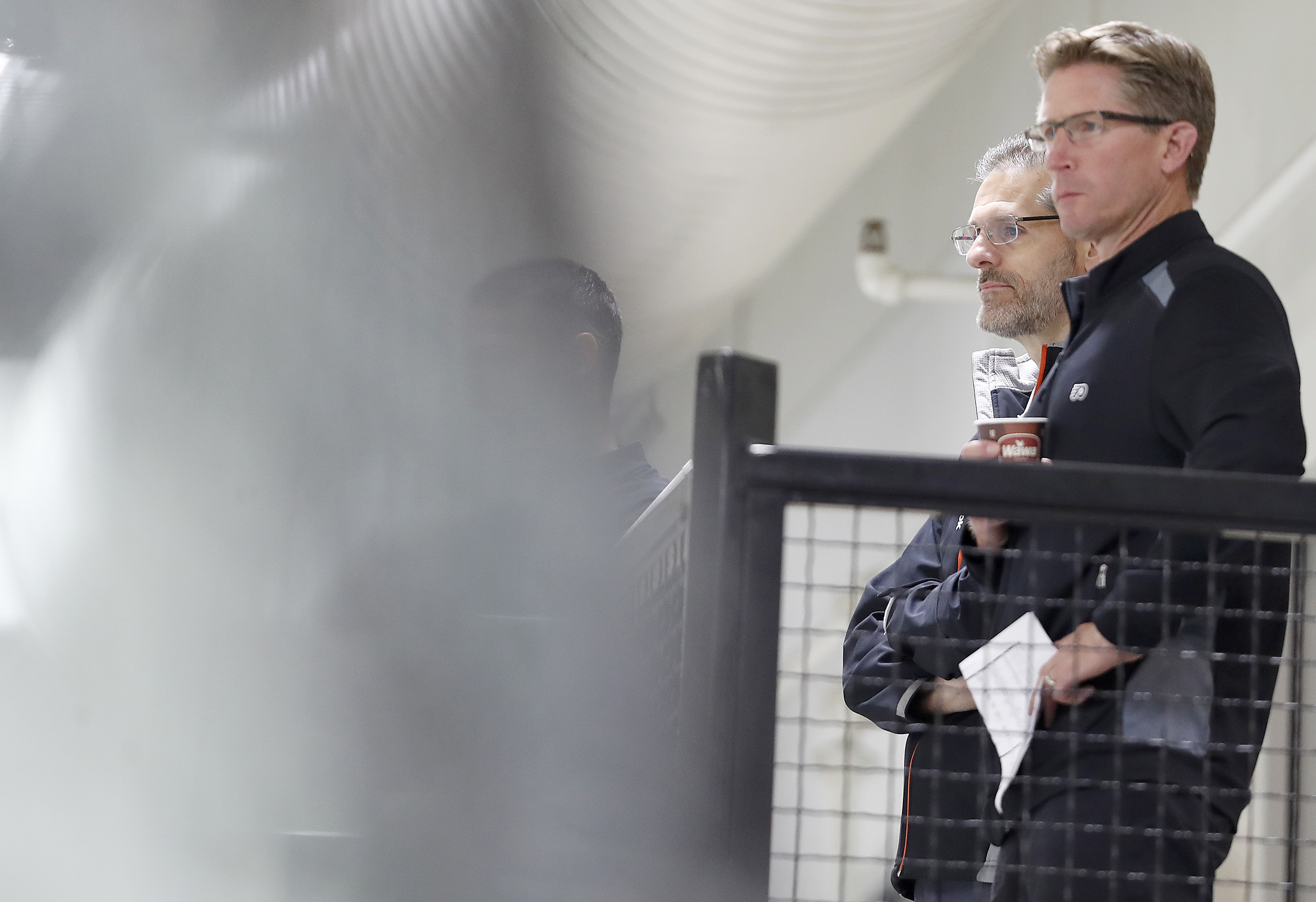 Flyers' executive vice president and general manager Ron Hextall, left, and head coach Dave Hakstol, right, watch during a development camp at the Flyers Skate Zone in Voorhees, NJ on July 8, 2017.