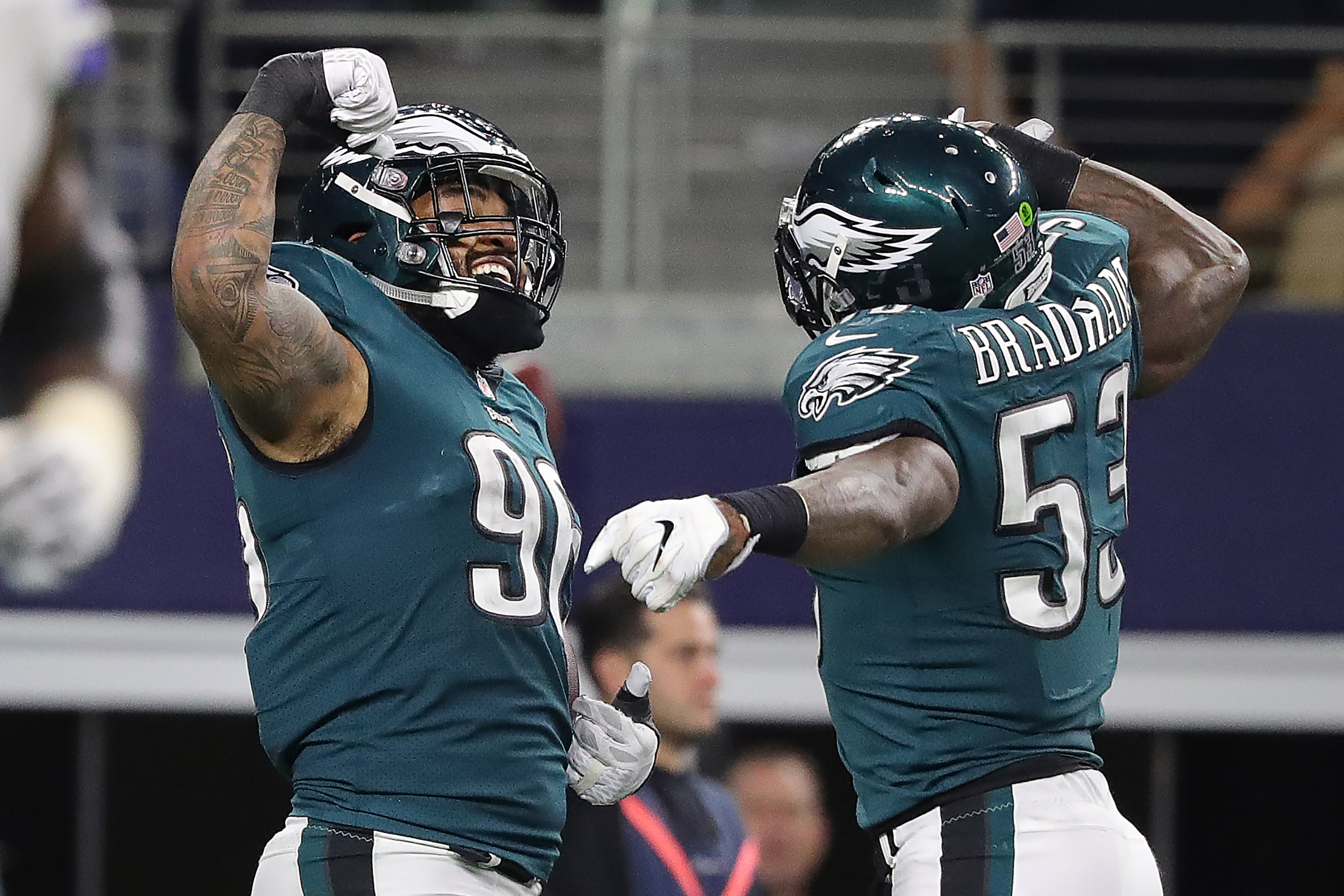Eagles' Derek Barnett, left, and Nigel Bradham, right, celebrate after Barnett forced a fumble and Bardham returned it for a touchdown against the Cowboys.