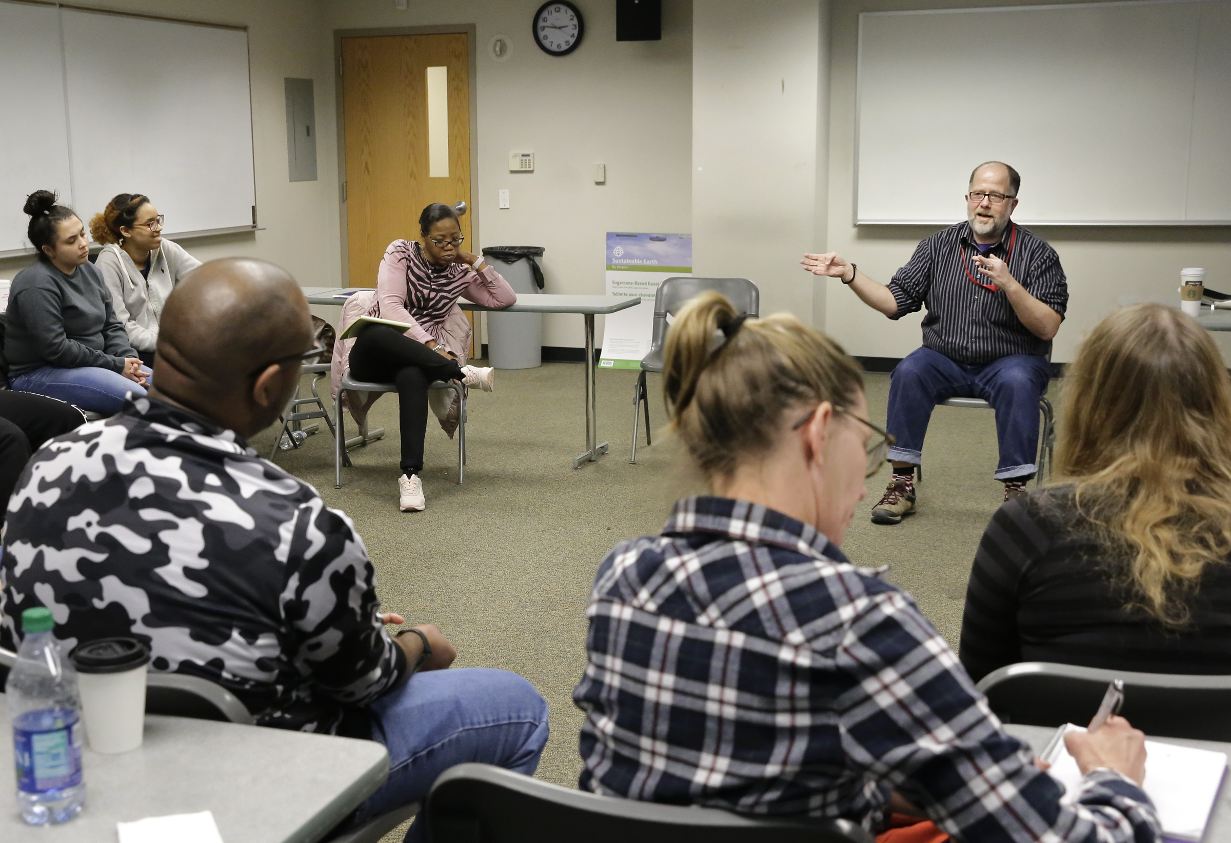 Jeff Draine (right) leads a discussion in his social justice class.