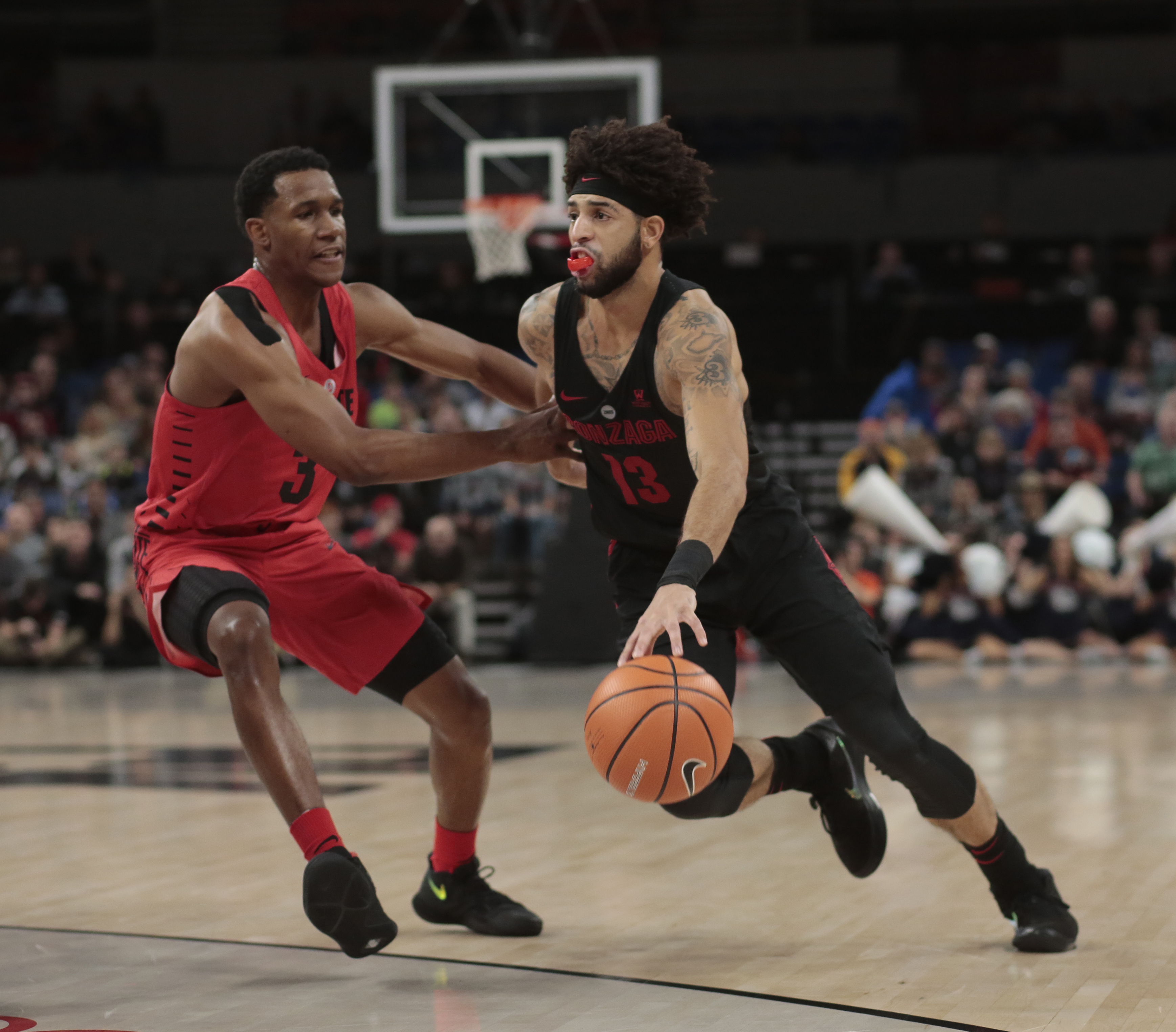 Ohio State´s C.J. Jackson (3) guards Gonzaga´s Josh Perkins (13) in the first half of an NCAA college basketball game during the Phil Knight Invitational tournament in Portland, Ore., Thursday, Nov. 23, 2017. (AP Photo/Timothy J. Gonzalez)