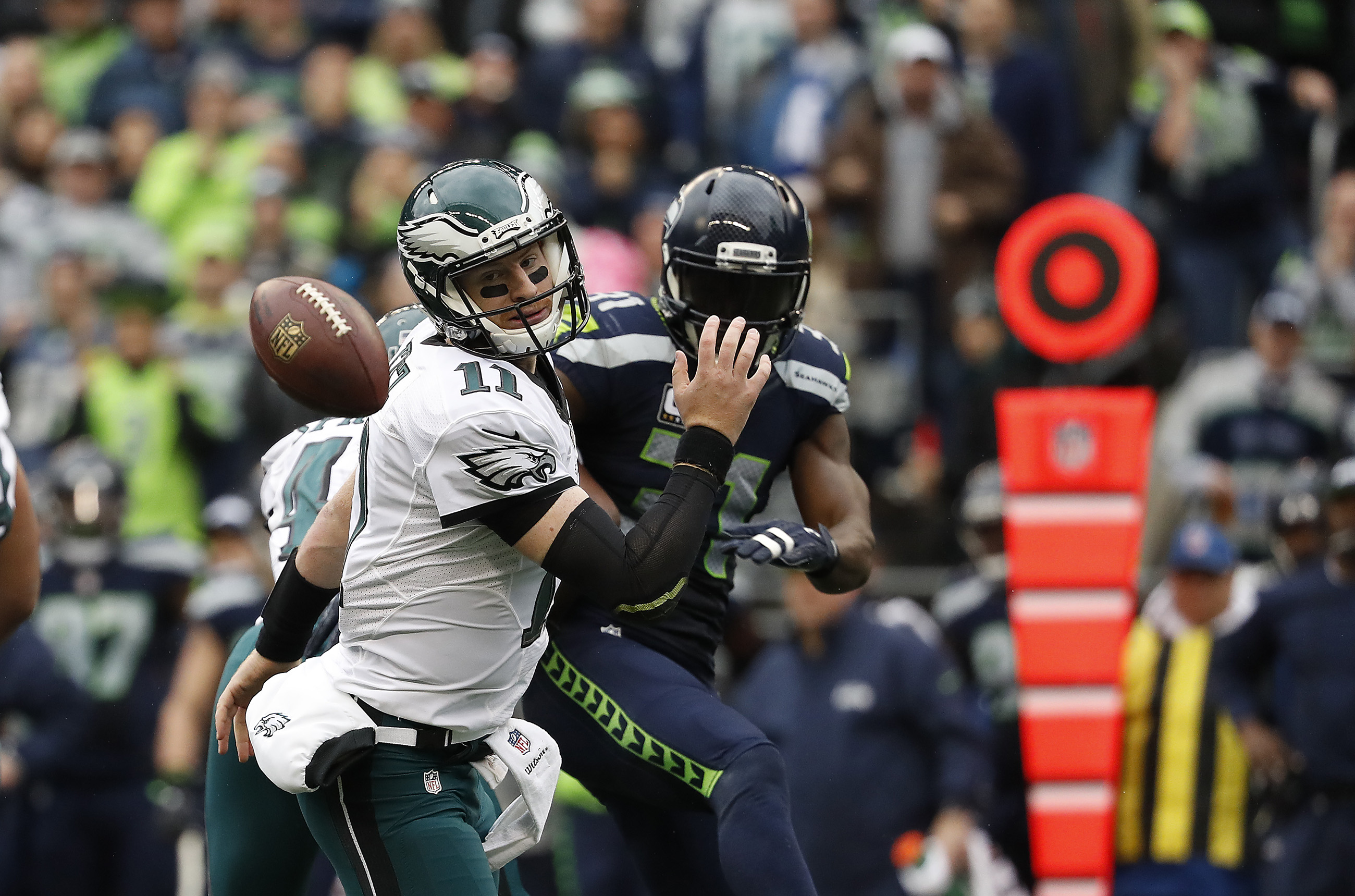 Eagles' Carson Wentz, left, has a pass blocked by the Seahawks' Kam Chancellor, right, during the 2nd quarter as the Philadelphia Eagles play the Seattle Seahawks in Seattle, WA on November 20, 2016.