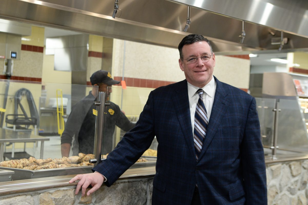 ShopRite owner Jeff Brown displays the new Authentic Fire Grilled Chicken station of the Island Avenue store in Eastwick on Dec. 15.