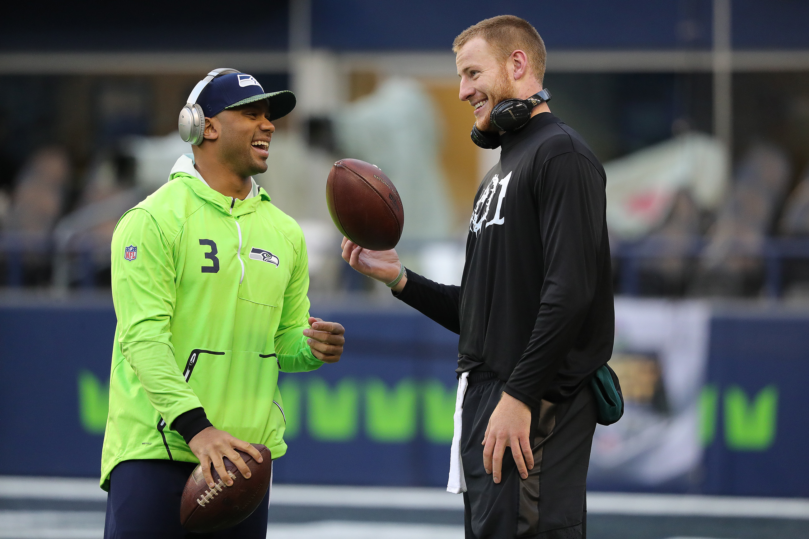 Seahawks' Russell Wilson, left, and Eagles' Carson Wentz, right, talk as they warm up before the Philadelphia Eagles play the Seattle Seahawks in Seattle, WA on December 3, 2017. DAVID MAIALETTI / Staff Photographer