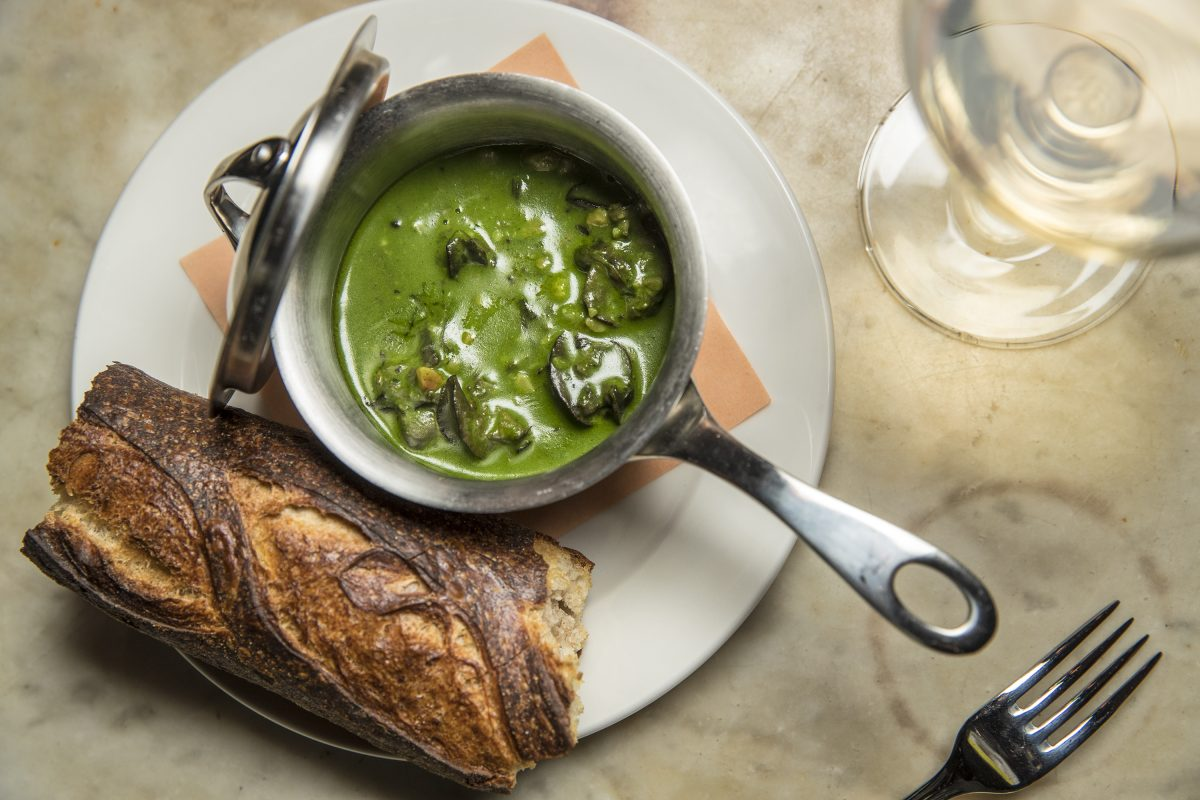 The Champagne Braised Escargot with chartreuse-hazelnut butter and crisp baguette at Royal Boucherie.