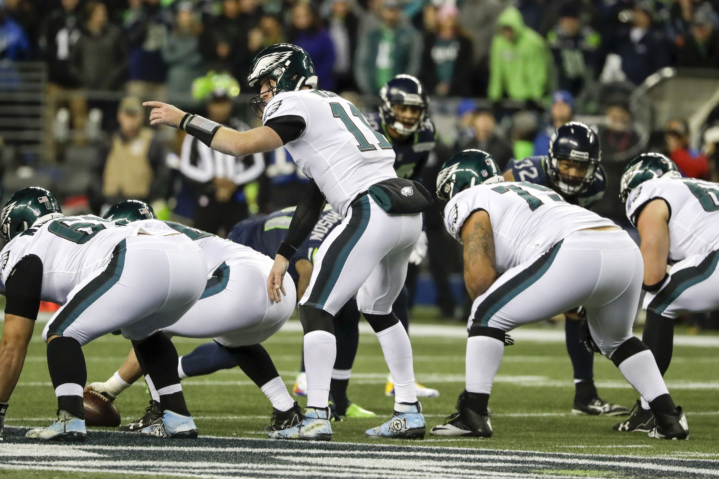 Eagles quarterback Carson Wentz points at the line against Seattle Seahawks on Sunday, December 3, 2017 at CenturyLink Field in Seattle. YONG KIM / Staff Photographer