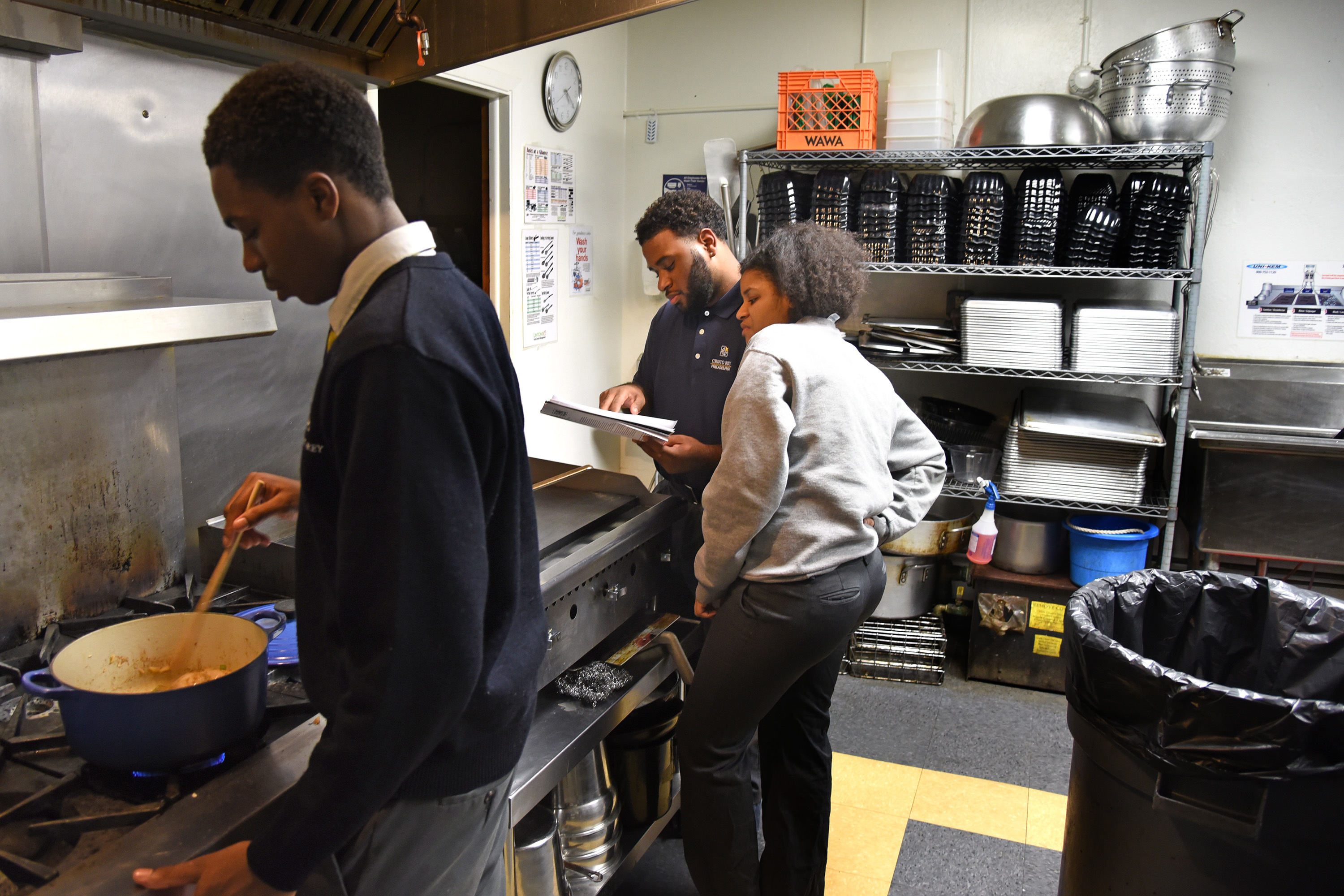 Dashaun Dunmeyer (left) stirs the chicken tortilla soup in the pot as Malachi Campbell (center) and Essence Battle (right) read the directions.