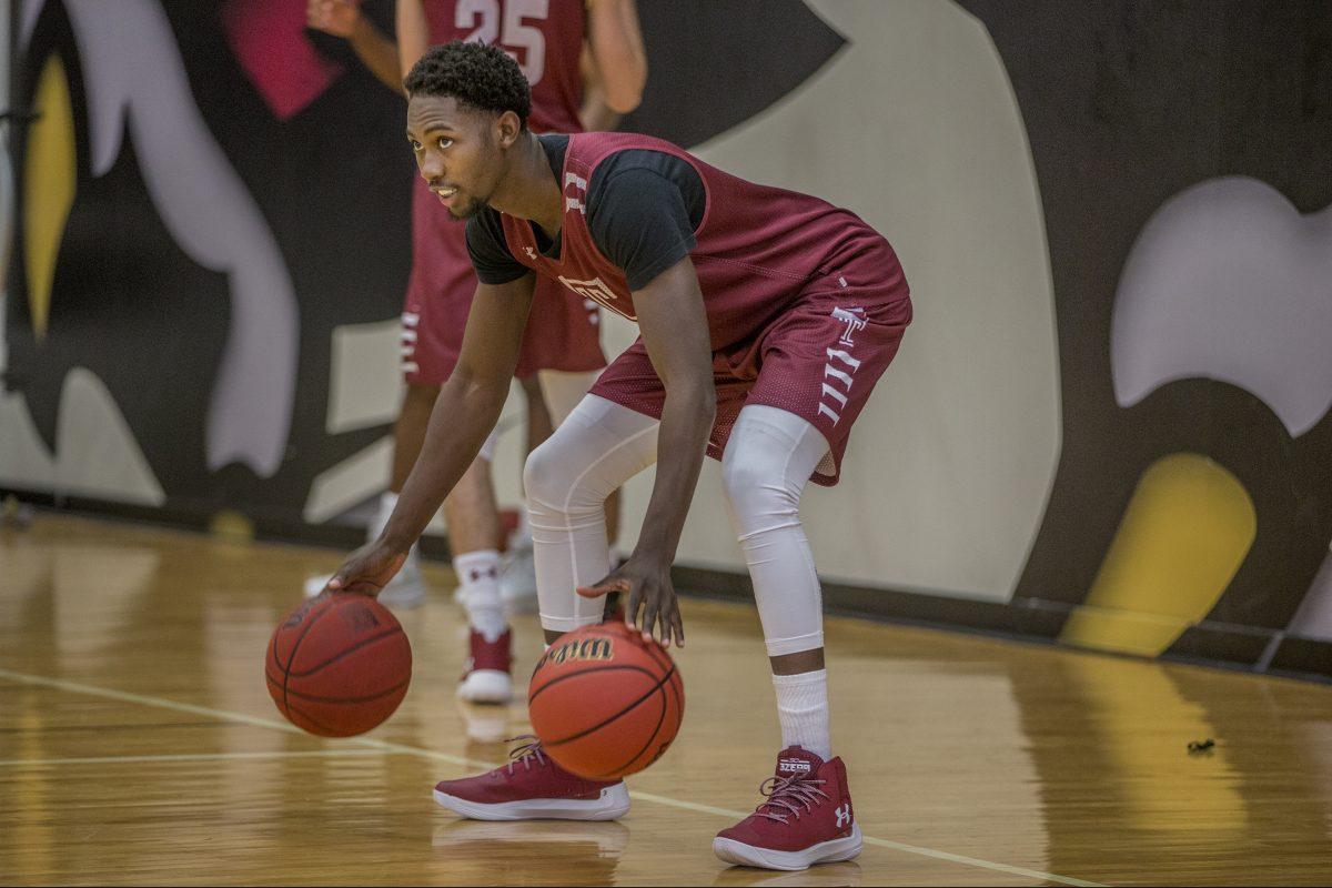 Temple's Shizz Alston Jr. dribbles two balls at once during a practice on Temple media day in October.