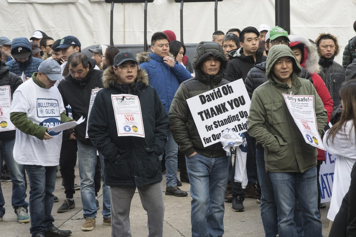Hundreds of protesters gathered outside City Hall on Monday, Dec. 4, 2017, to rally against a bill introduced by Councilwoman Cindy Bass that would force beer deli owners to take down protective safety windows in their establishments.