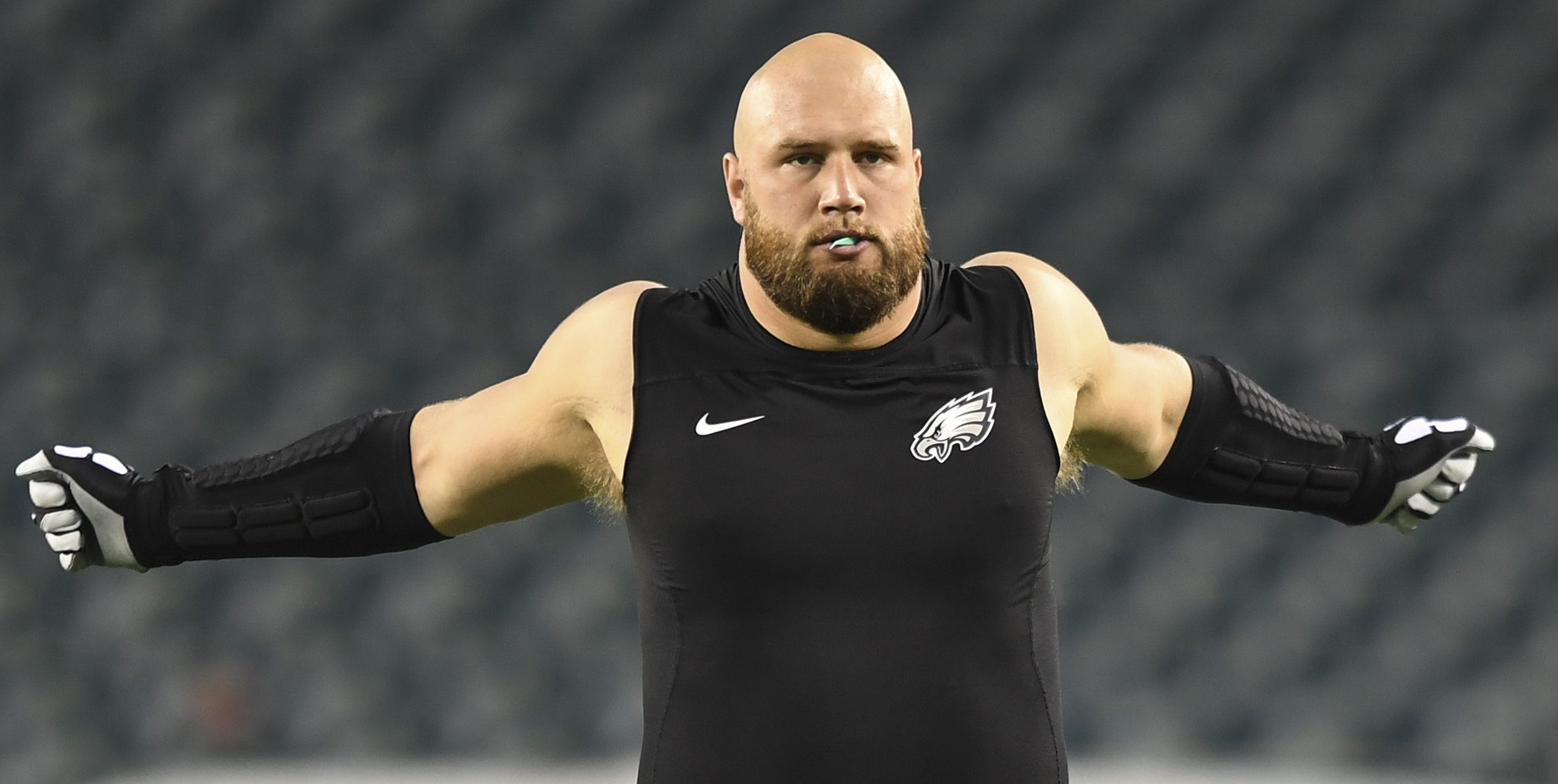 Eagles right tackle Lane Johnson stretches before a game.