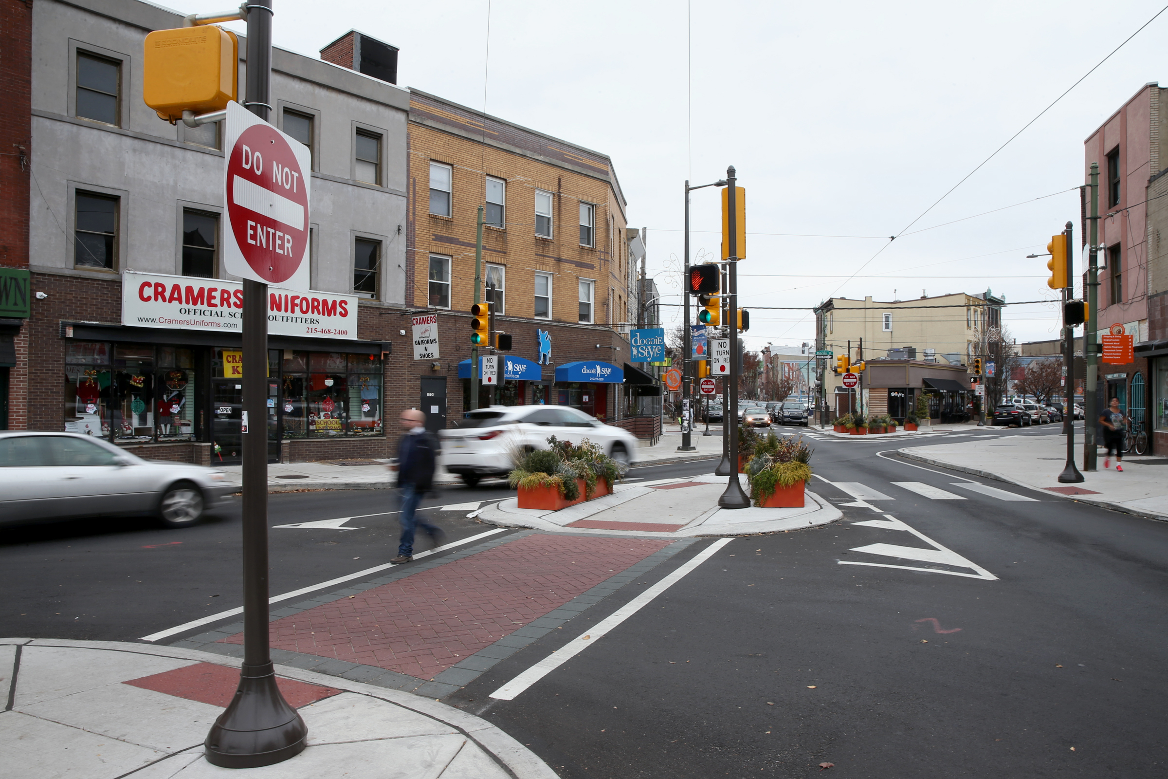 A new pedestrian crosswalk at 12th and Passyunk uses the same red, stamped asphalt that will be installed on South Broad Street. The intersection was just rebuilt to make it safer.