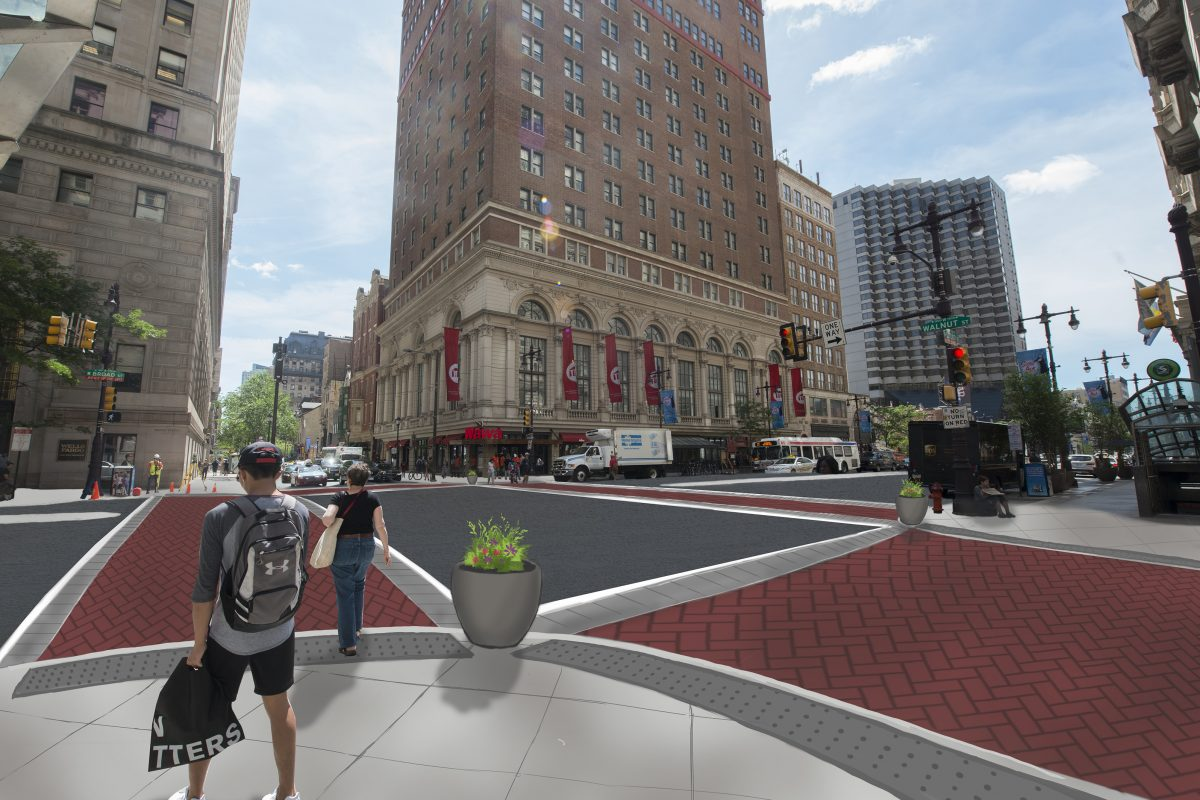 Philadelphia's Streets Department is building three curbless instersections on South Broad Street to increase pedestrian safety. The crosswalks will be finished with stamped red asphalt in a brick pattern.