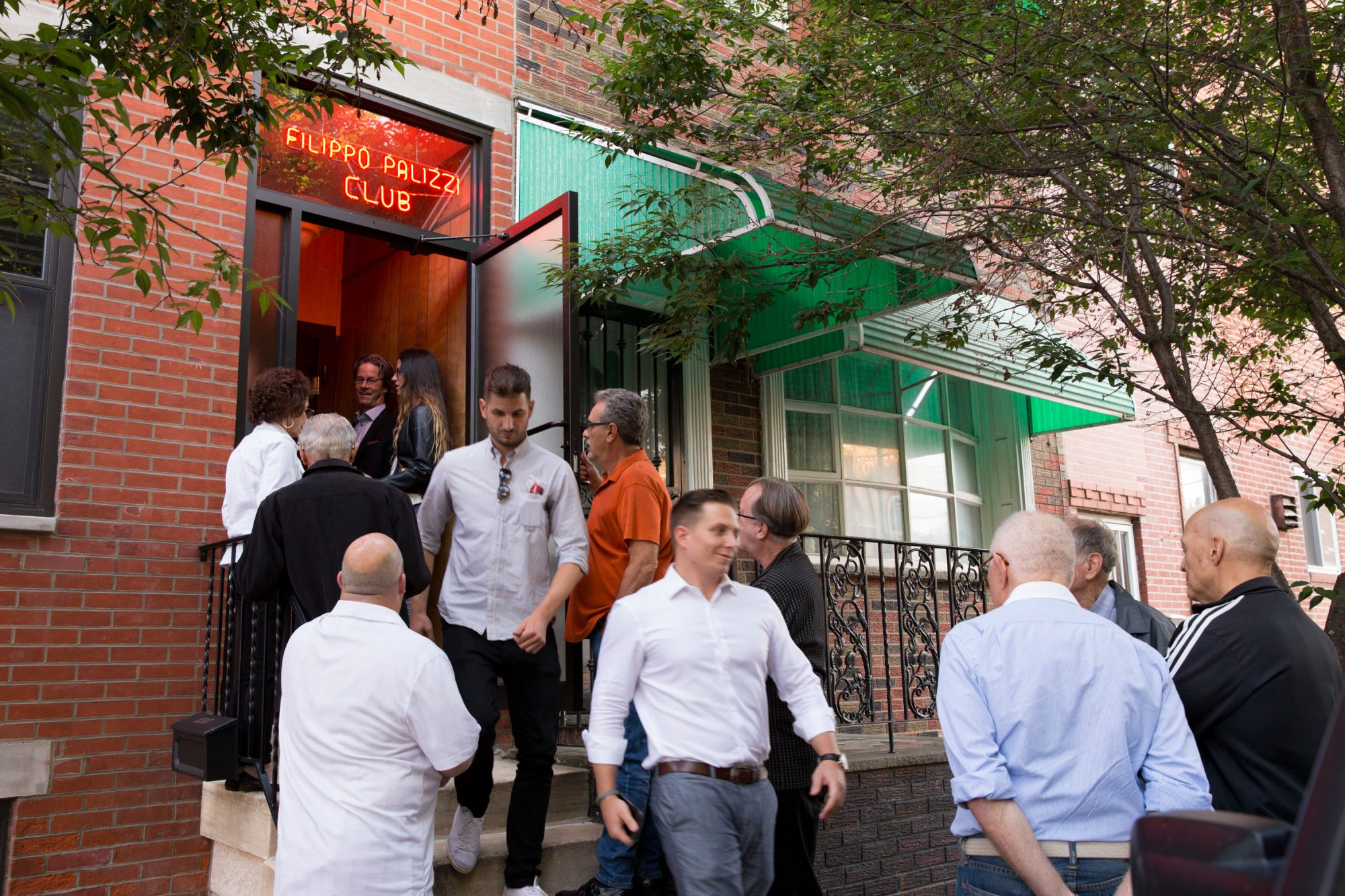 Patrons at the entrance of the Palizzi Social Club, JESSICA GRIFFIN / Staff Photographer