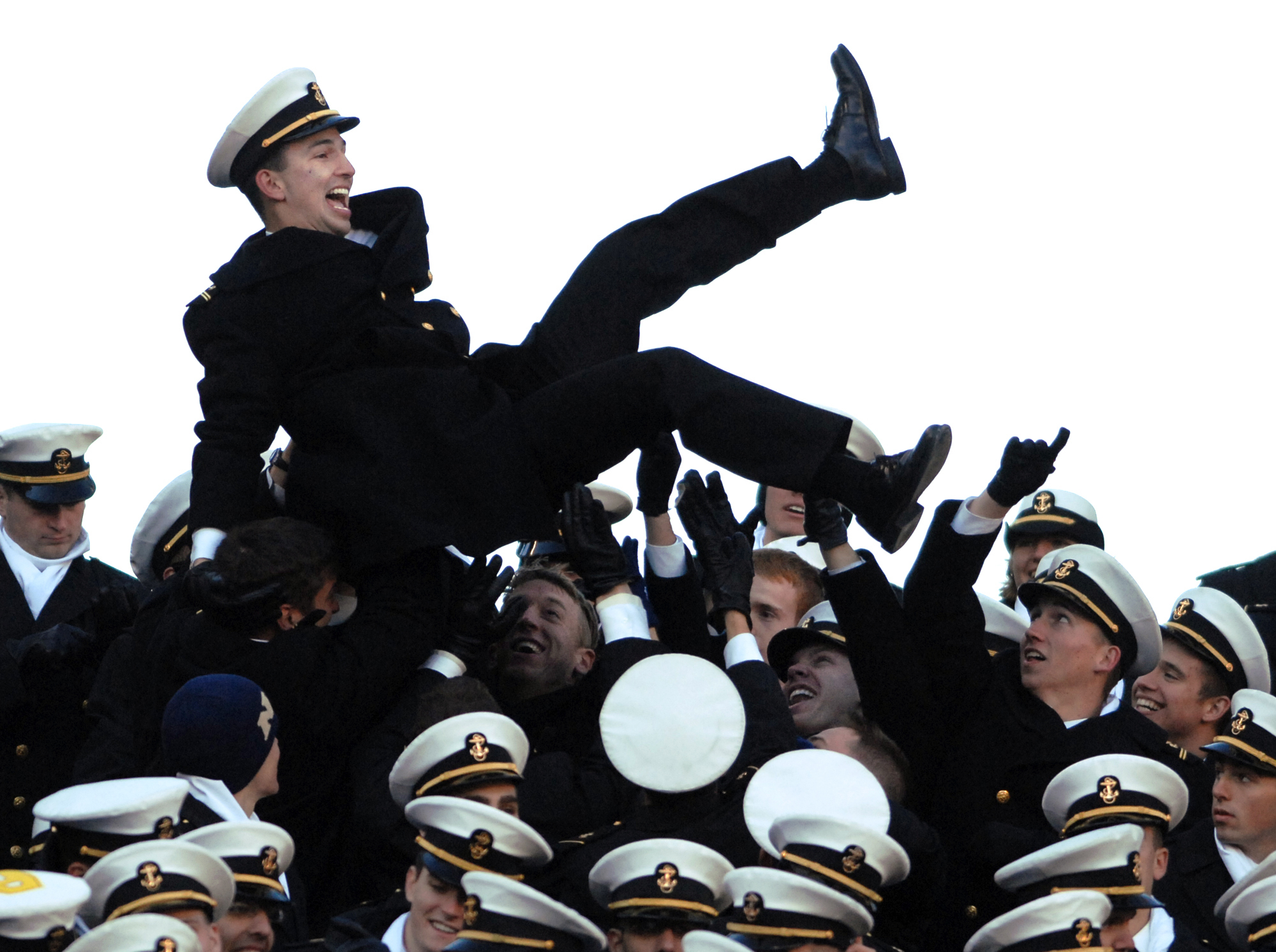 A Navy Midshipman is tossed into the air by his fellow midshipmen as the celebrate Navys first touchdown in 2006 at the Linc.