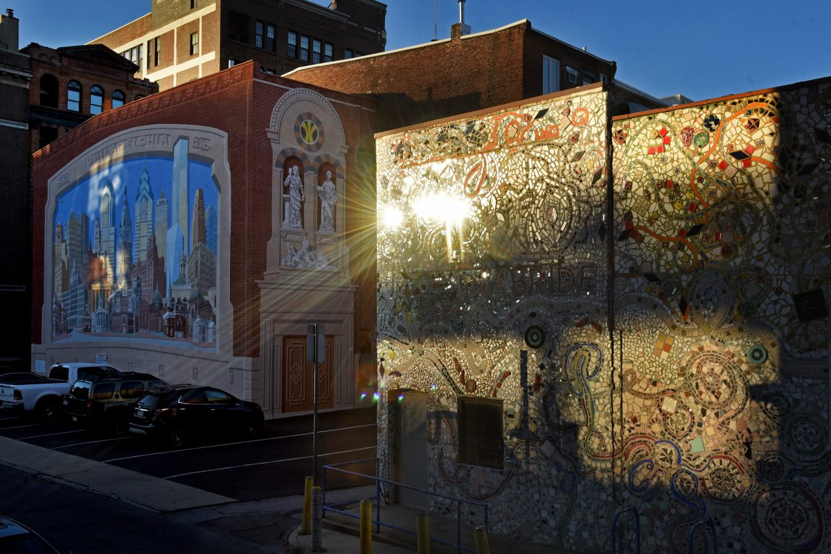 The setting sun reflects off Isaiah Zagar's mosaics on the Painted Bride Wednesday. Executive Director Laurel Raczka says the sale of the building on Vine Street in Old City will help position the arts group for a vital future.