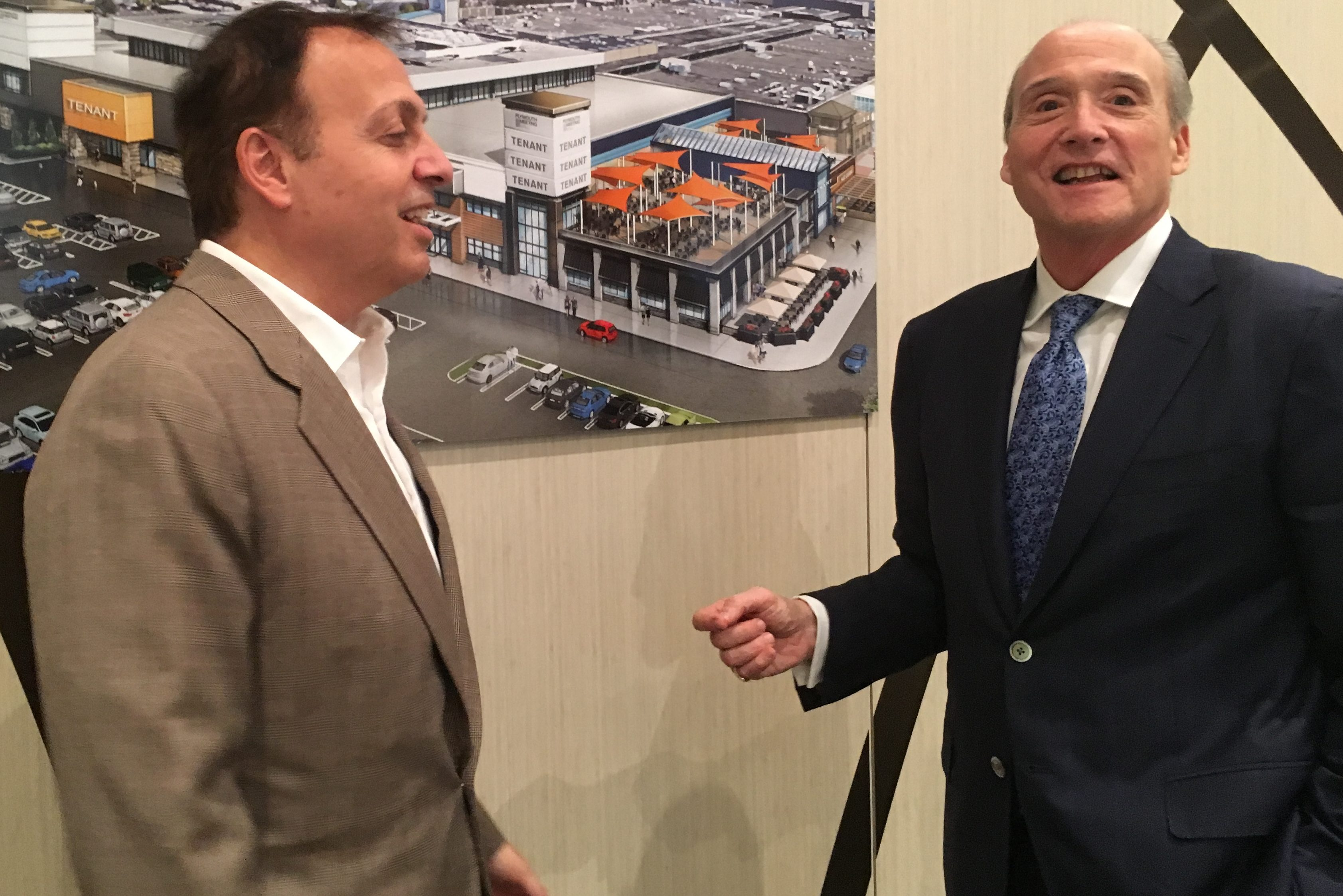 PREIT CEO Joe Coradino (right) stands with architect Frankie J. Campione who works on many PREIT malls, at PREIT´s booth at the International Council of Shopping Centers (ICSC) New York Dealmaking Conference this week.