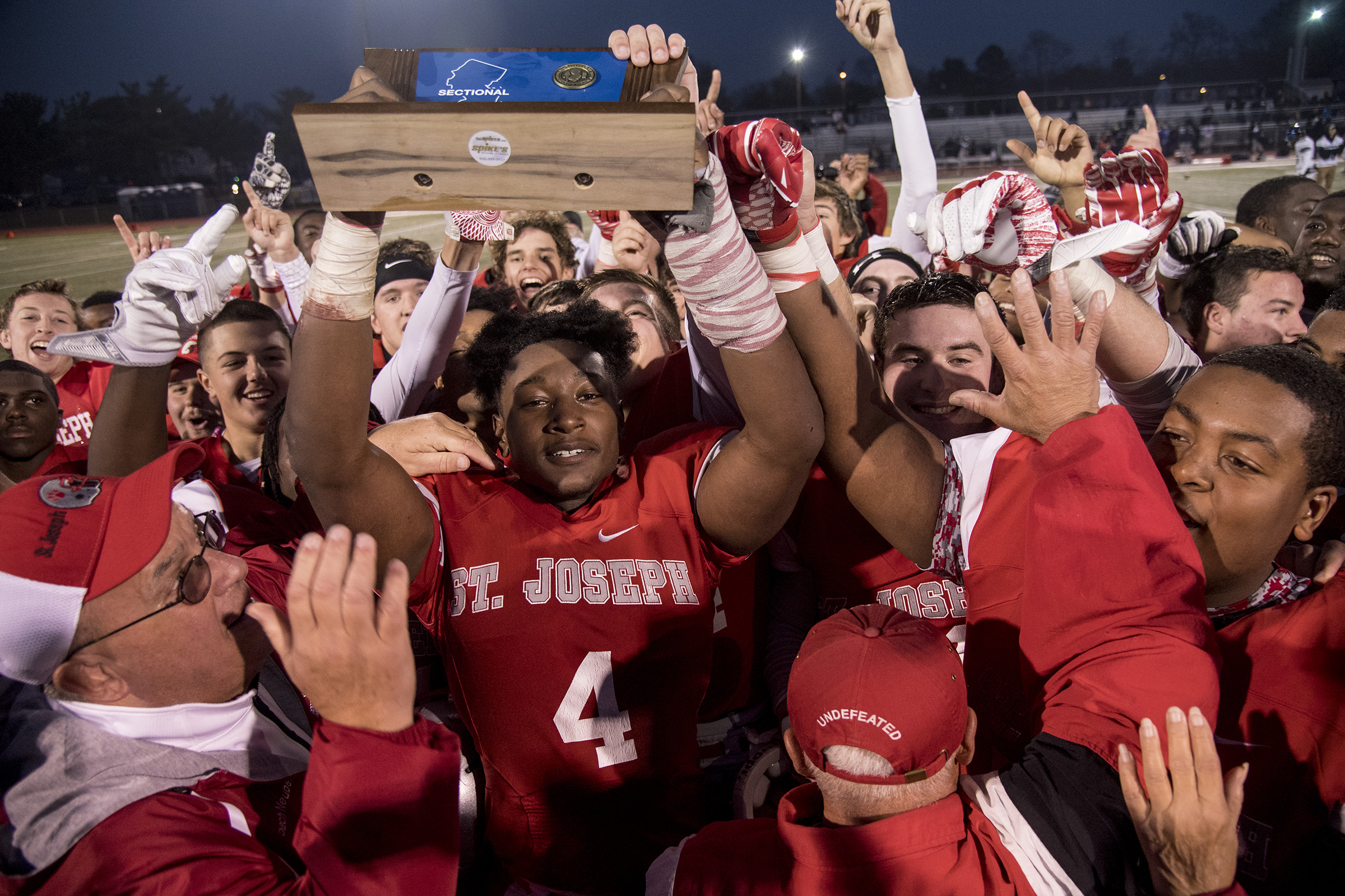 St. Joseph senior Qwahsin Townsel and teammates celebrate state title.
