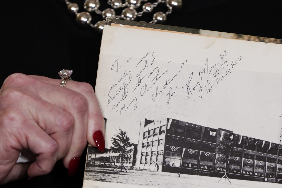 Beverly Young Nelson shows her high school yearbook, allegedly signed by Roy Moore, at a news conference in New York on Monday, Nov. 13, 2017.
