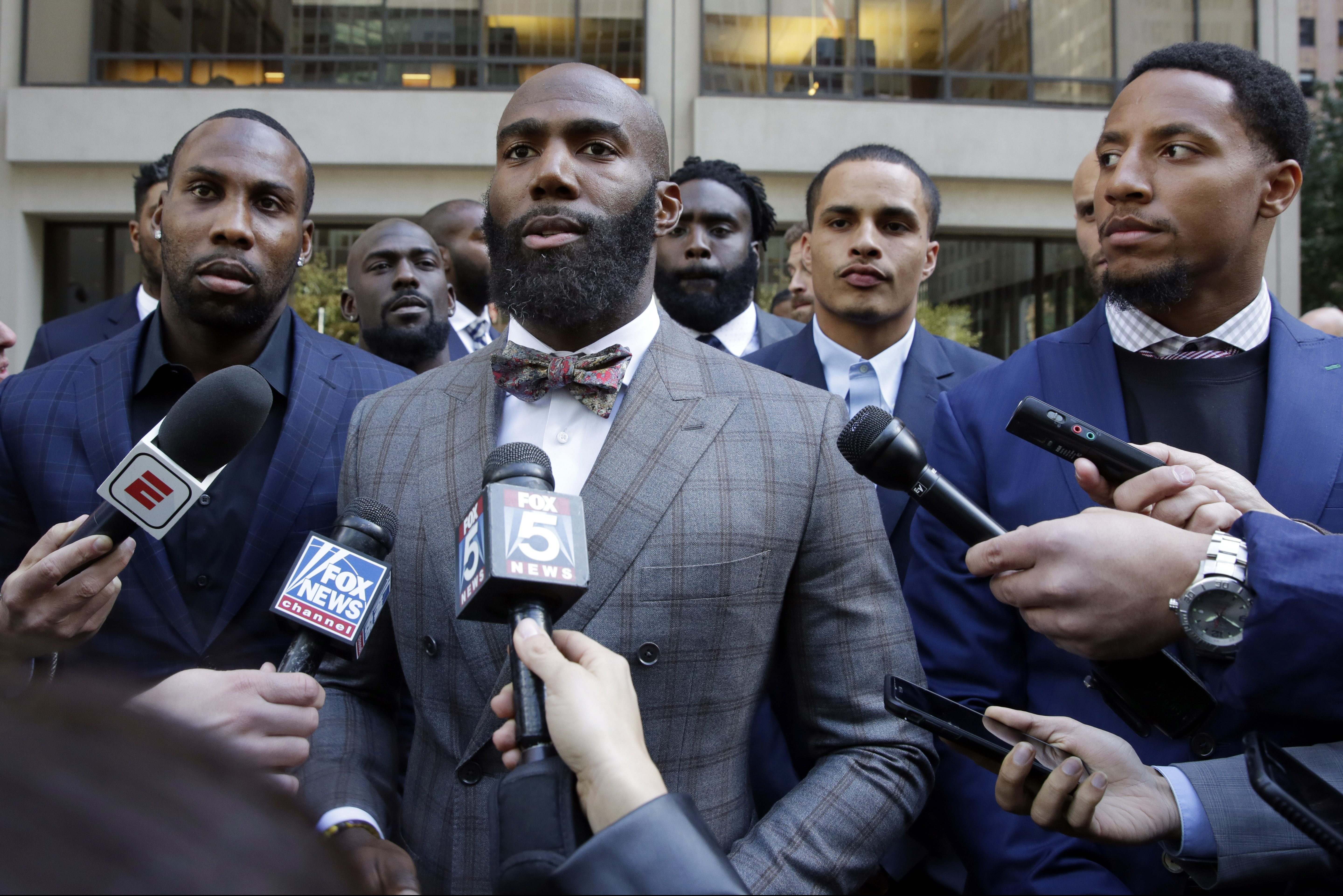 Anquan Boldin, left, Malcolm Jenkins, center, and Eric Reid, right, speak to the media outside NFL headquarters in New York as part of the Players Coalition back in October.