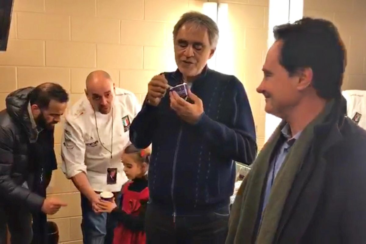 Andrea Bocelli (center) samples Desire gelato brought to his Wells Fargo Center dressing room by Gran Caffe L'Aquila owners (from left) Michele Morelli, Stefano Biasini, and Riccardo Longo.