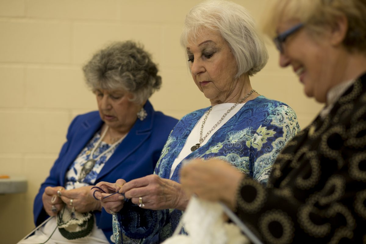 Mickie Levin (left), Joyce Adelman and Ella Kruglikov knit for Mim & Ray at KleinLife, a senior center in Northeast Philadelphia.