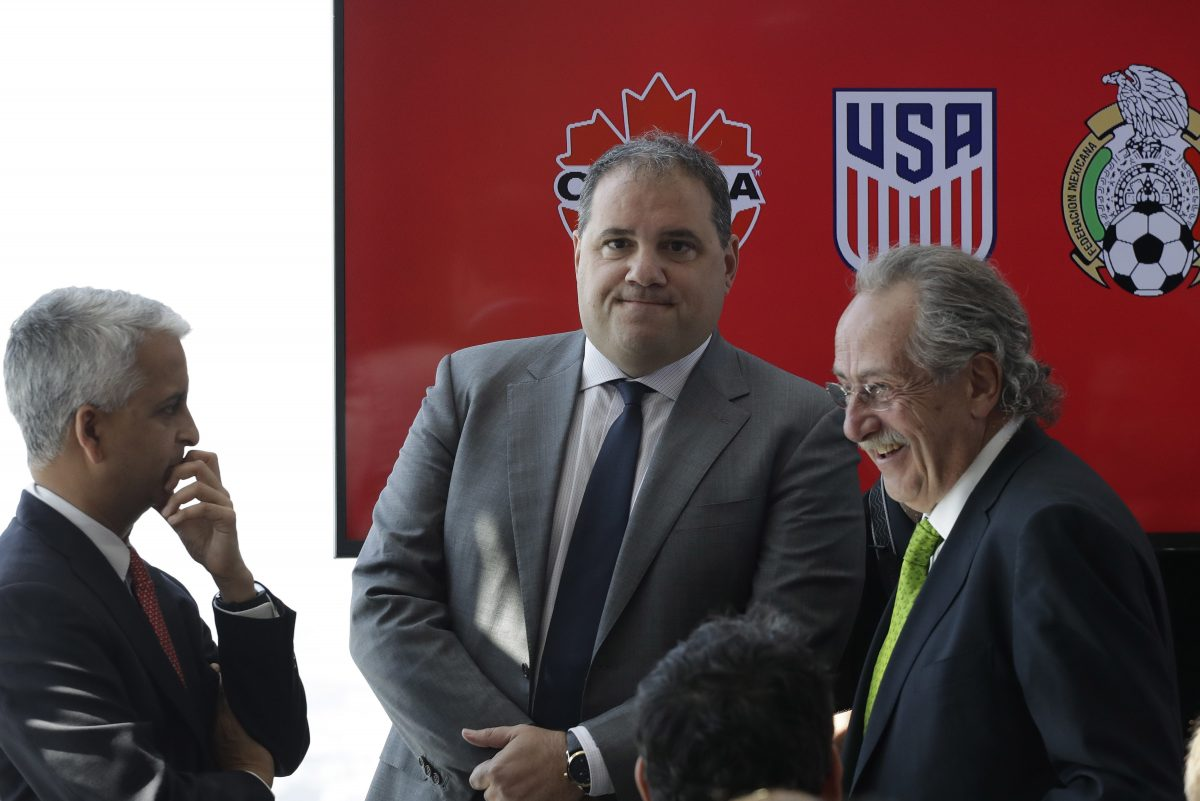 CONCACAF president Victor Montagliani of Canada (center) with United States Soccer Federation president Sunil Gulati (left) and Mexican federation president Decio De Maria (right) at a press conference last April to announce the nations' joint bid to host the 2026 FIFA World Cup.