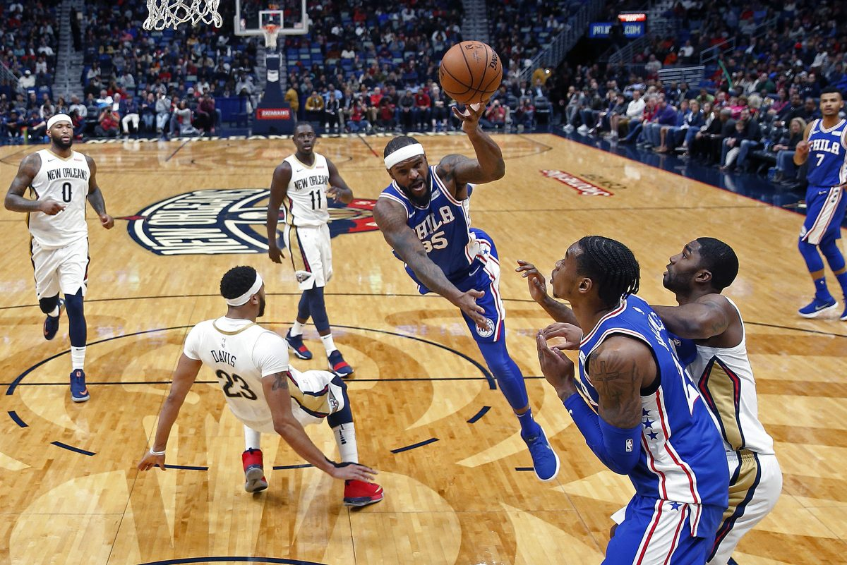 76ers forward Trevor Booker (35) is fouled by New Orleans Pelicans forward Anthony Davis (23) as he drives to the basket in the first half.