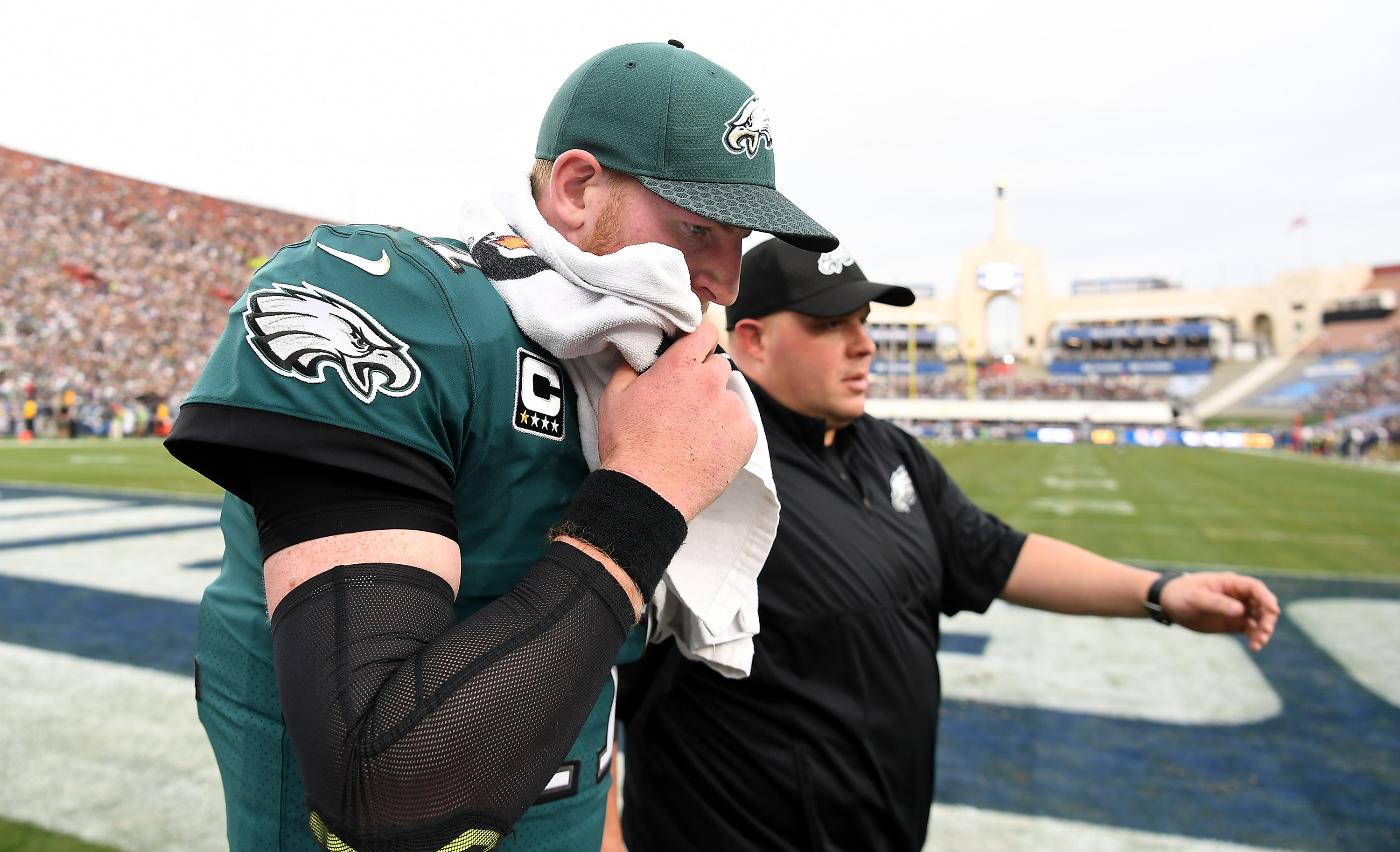 Eagles quarterback Carson Wentz walks off the field after injuring his knee.