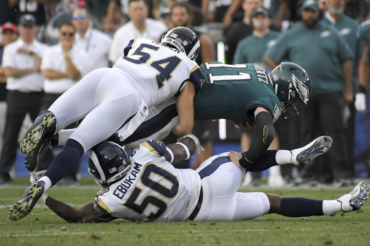 Philadelphia Eagles quarterback Carson Wentz suffered a knee injury during the third quarter of Sunday's 43-35 win over the Los Angeles Rams that took him out of the game.