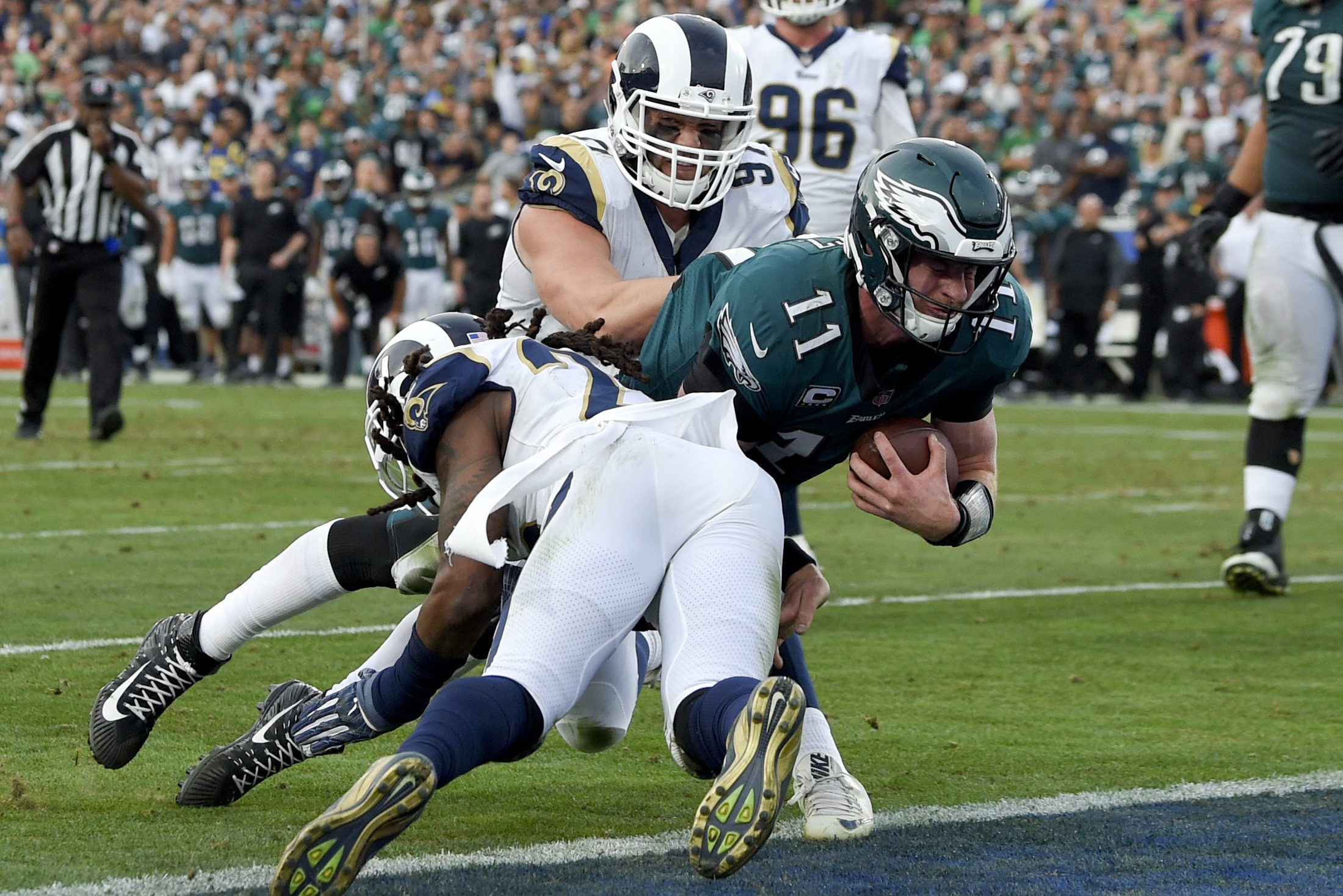 Carson Wentz gets tackled during the third quarter. He left the game shortly after the play and did not return.