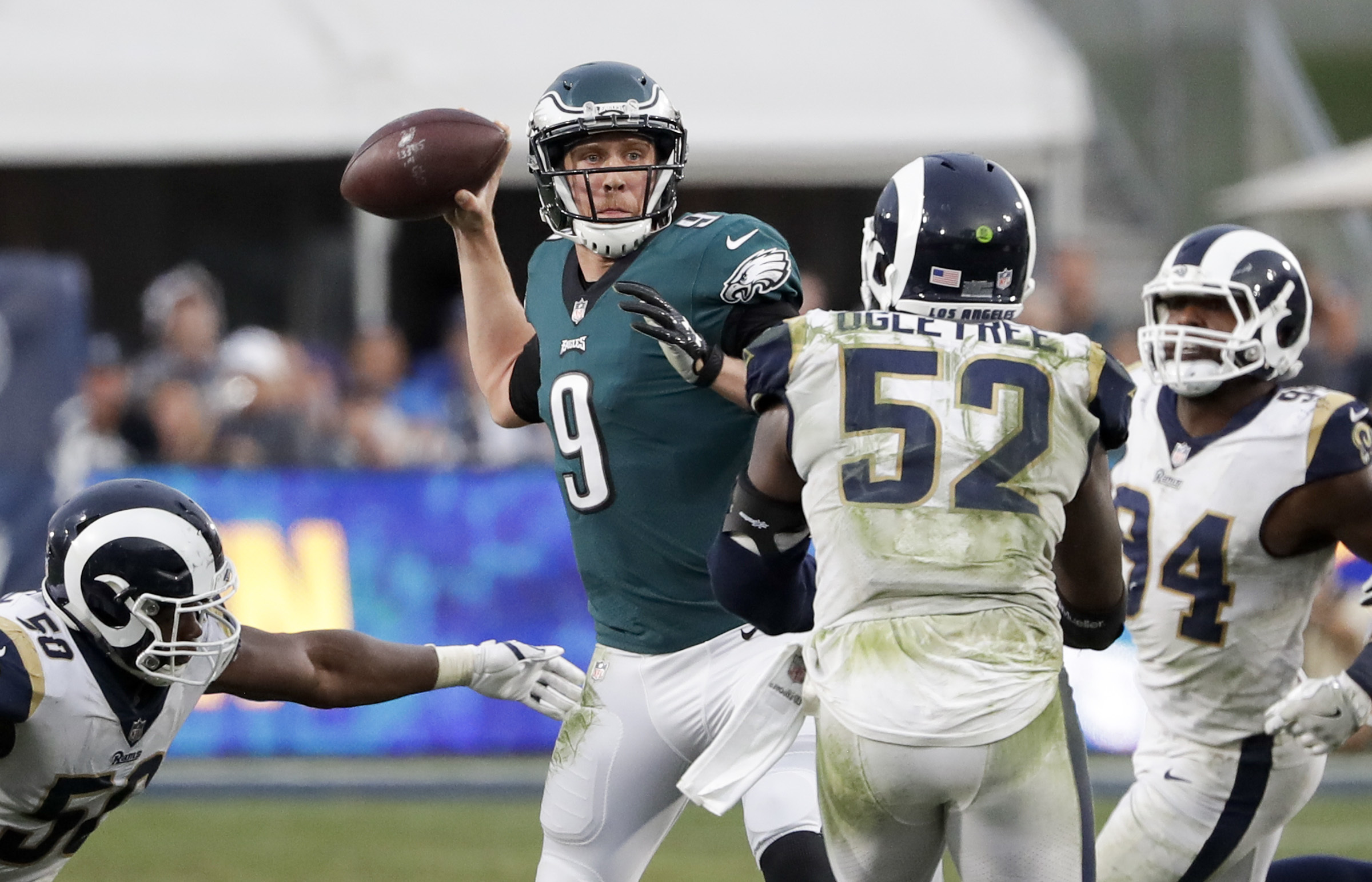 Eagles quarterback Nick Foles throws a pass against the Rams.