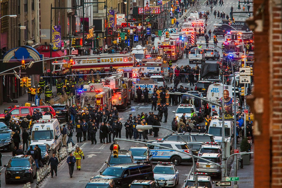 Police and firefighters work in front of the Port Authority Bus Terminal as police respond to a report of an explosion near Times Square on Monday.