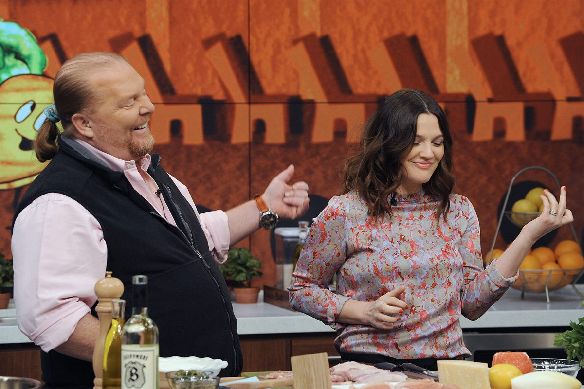 "Celebrity chef Mario Batali makes a meal with Drew Barrymore on ABC's ""The Chew."" Bataldi has stepped down from the show and his restaurants after allegations of sexual misconduct have surfaced."
