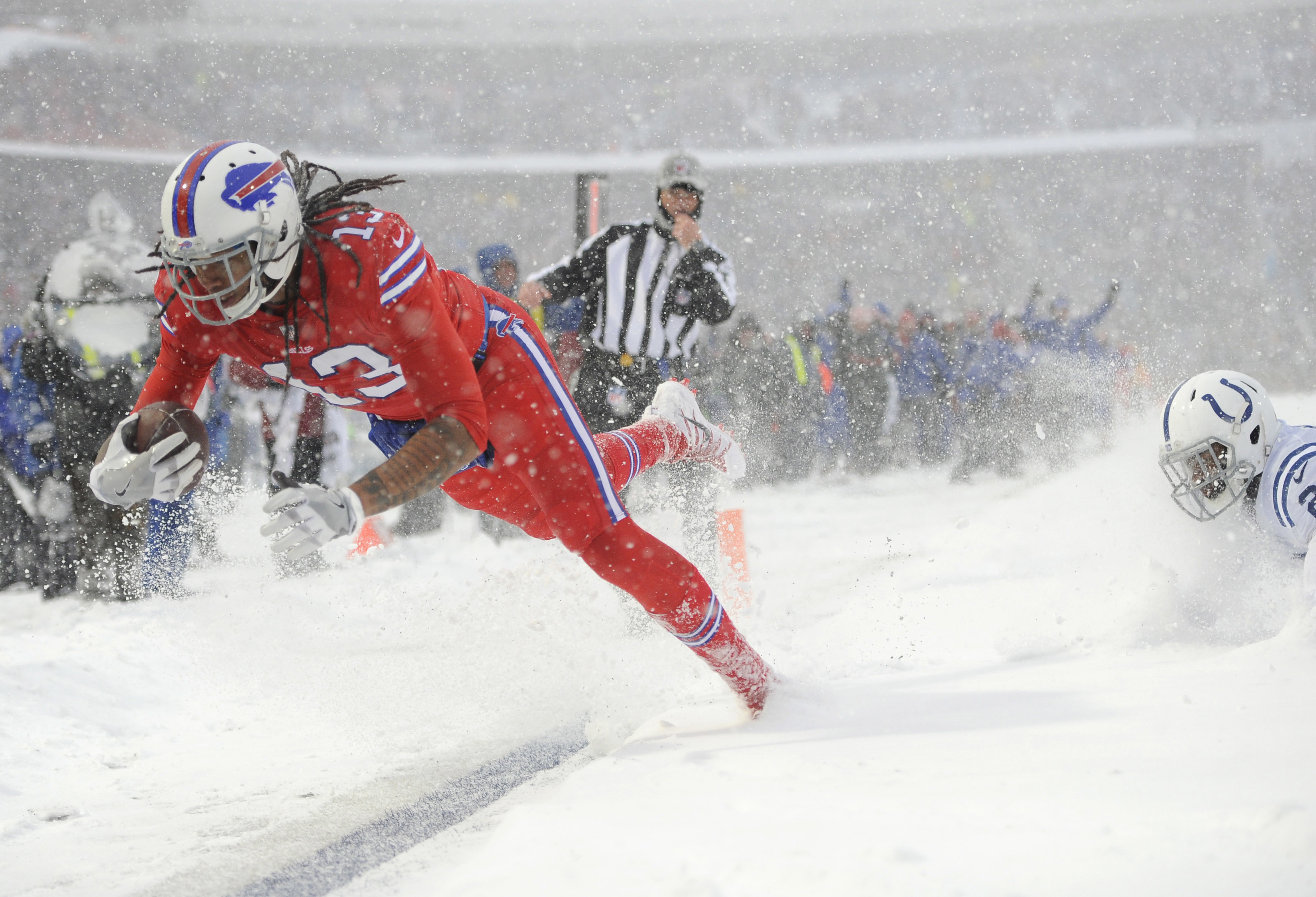Snow flurries are in the forecast again this week for Buffalo. Another blizzard would be wonderful for those who like to play the unders. (AP Photo/Adrian Kraus)