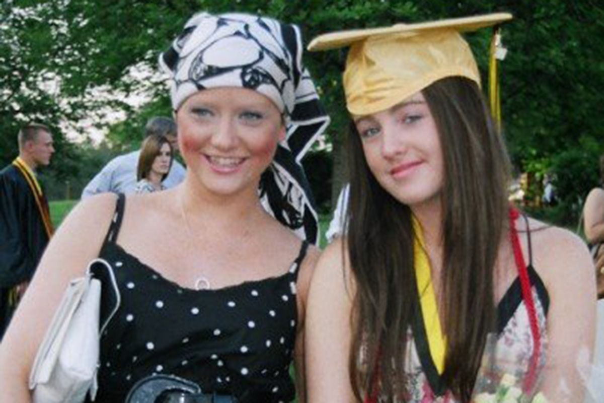 Sarah Happy, during her initial cancer treatment, celebrates her sister Juliet's high school graduation.